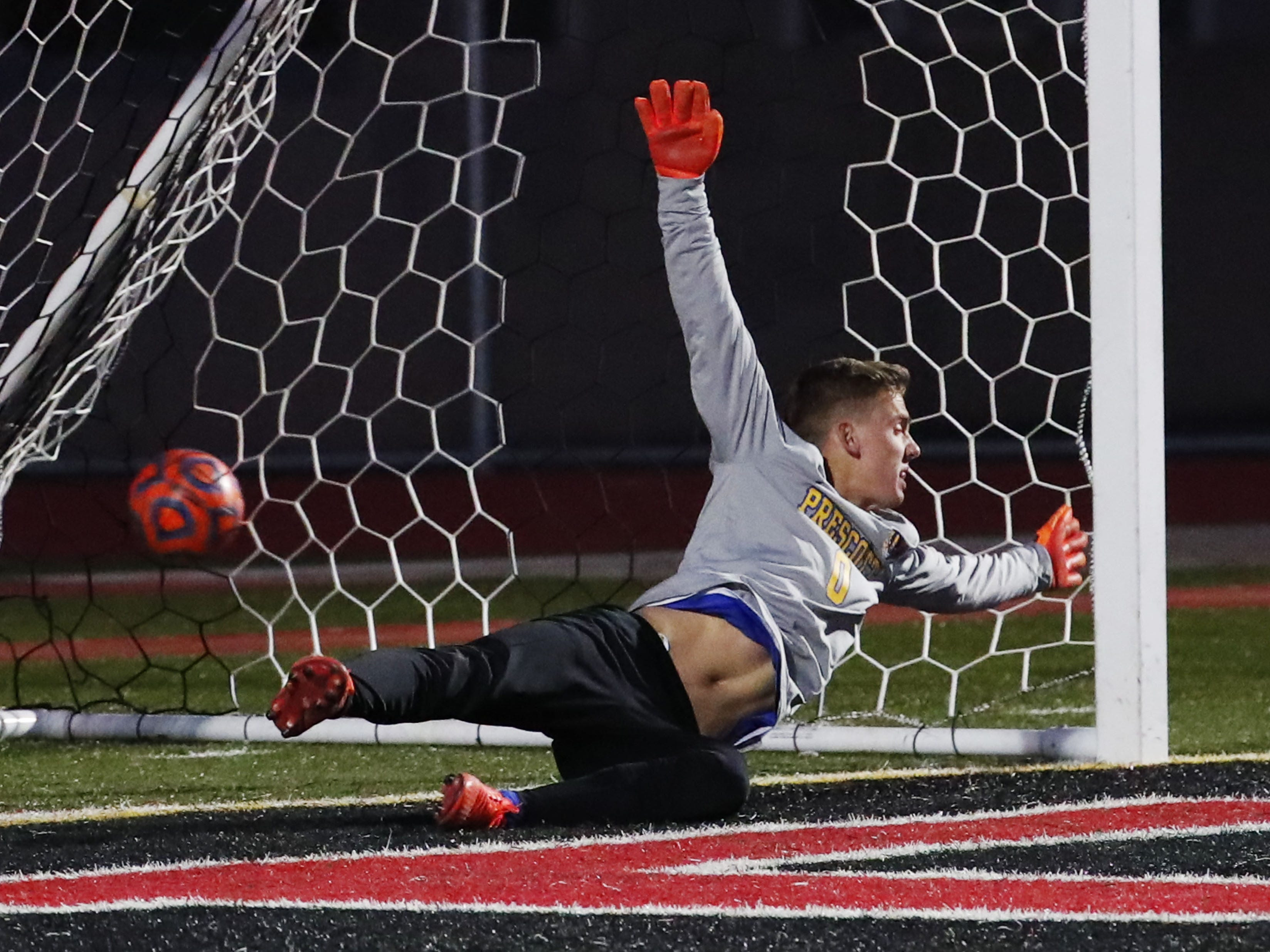 Prescott goal keeper Ryan Peeples dives for a penalty shot against Salpointe during the Boys 4A State Championship soccer game in Gilbert Feb. 19, 2019.