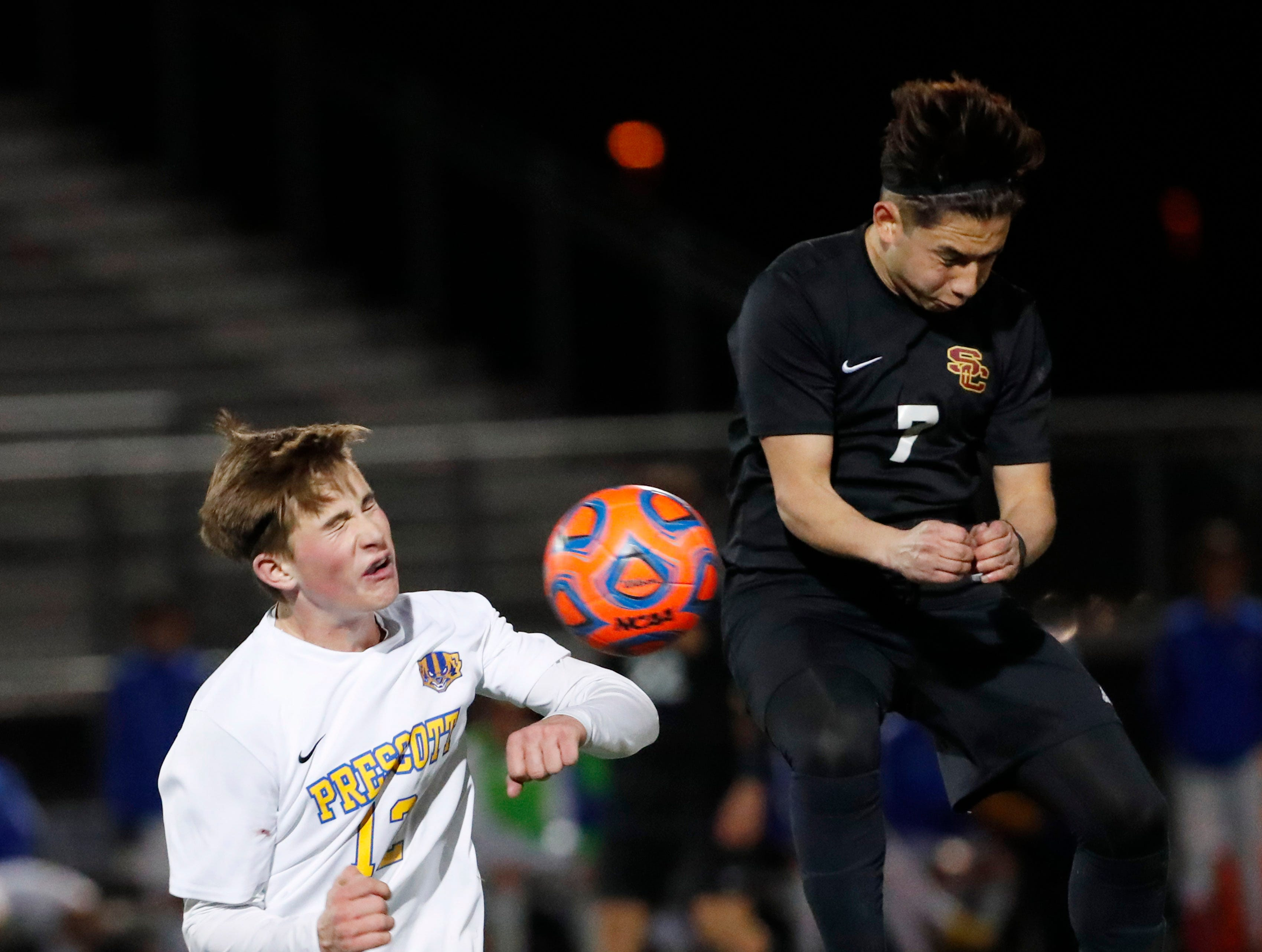 Prescott's Brayden Nelson (12) and Salpointe's Eric Galindo (7) battle for the ball during the Boys 4A State Championship soccer game in Gilbert Feb. 19, 2019.