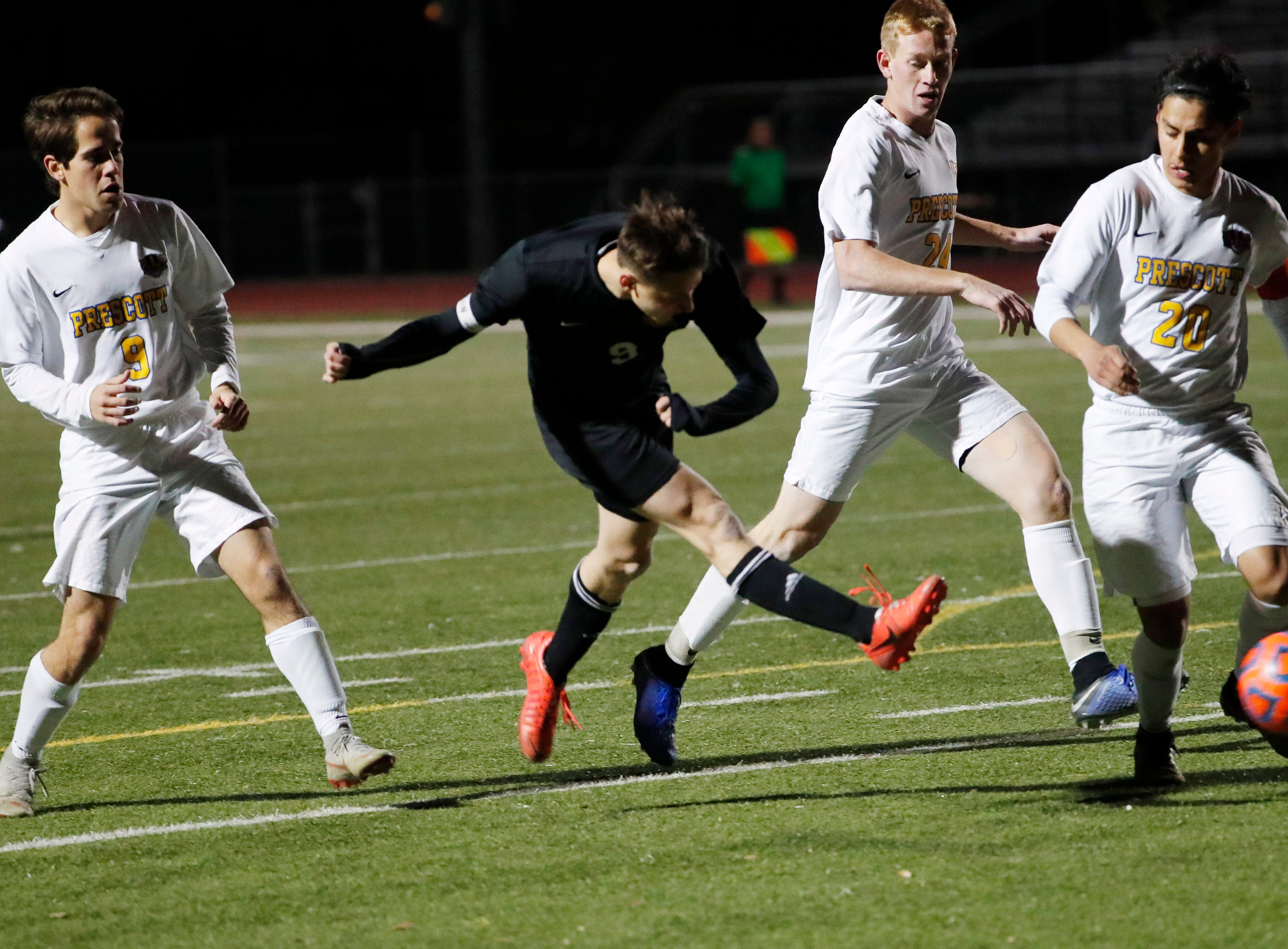 Salpointe's Francisco Manzo (9) scores the winning goal against Prescott during the Boys 4A State Championship soccer game in Gilbert Feb. 19, 2019.