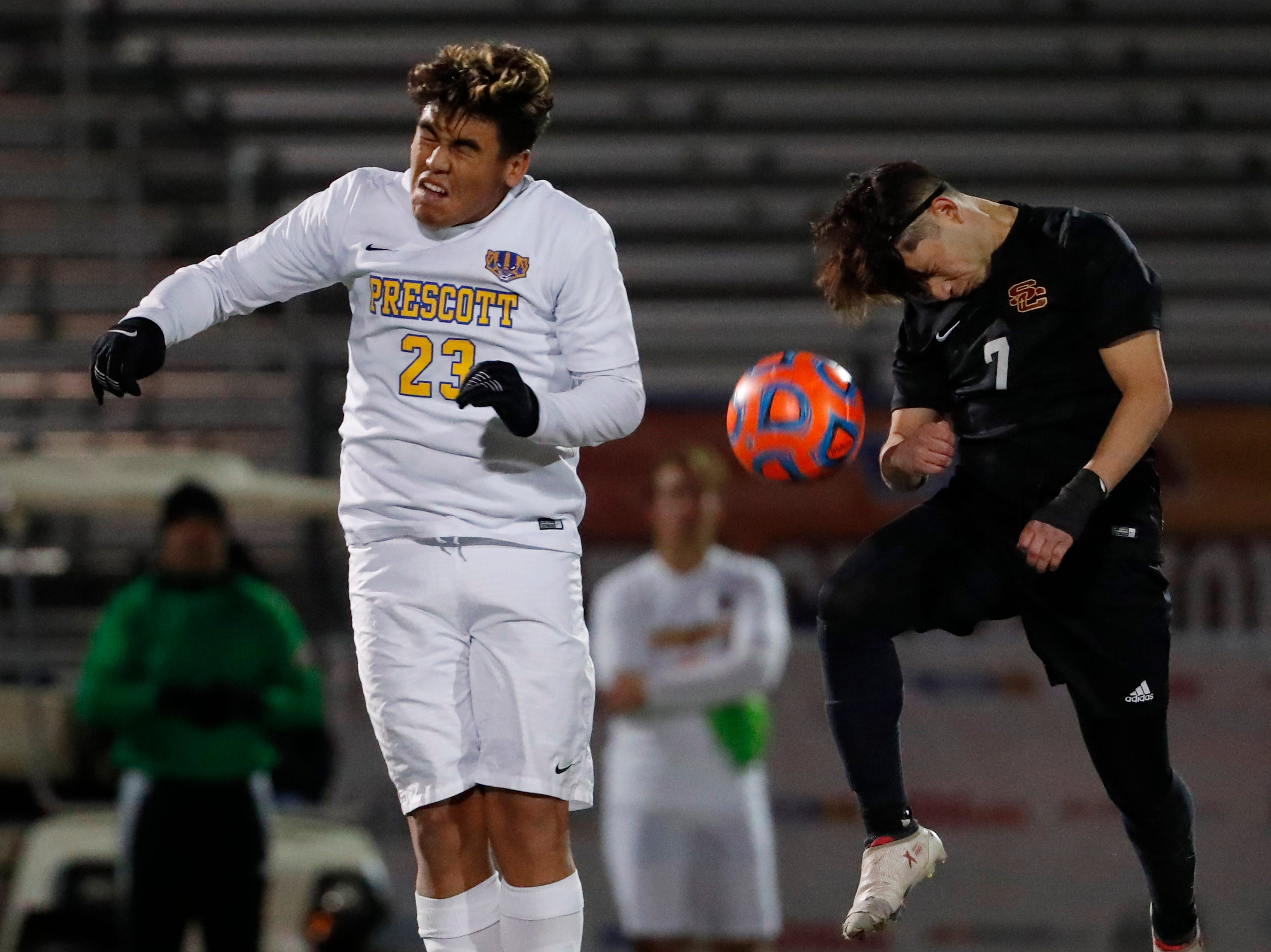 Prescott's Fernando Rodriguez (23) heads the ball against Salpointe's Eric Galindo (7) during the Boys 4A State Championship soccer game in Gilbert Feb. 19, 2019.