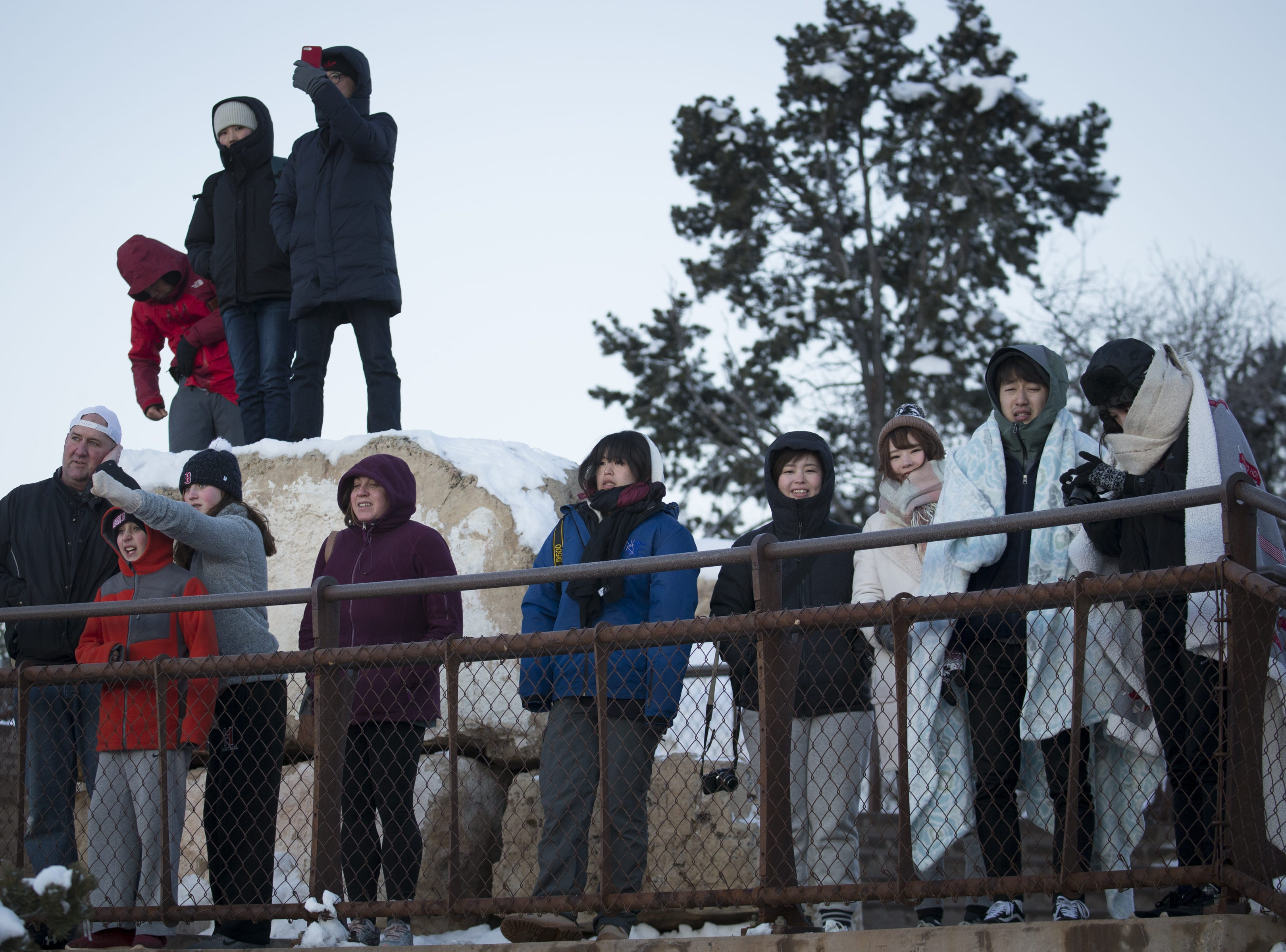 Visitors bundled up to view the sunrise at Mather Point on Feb. 20, 2019, at the South Rim of Grand Canyon National Park, Arizona.
