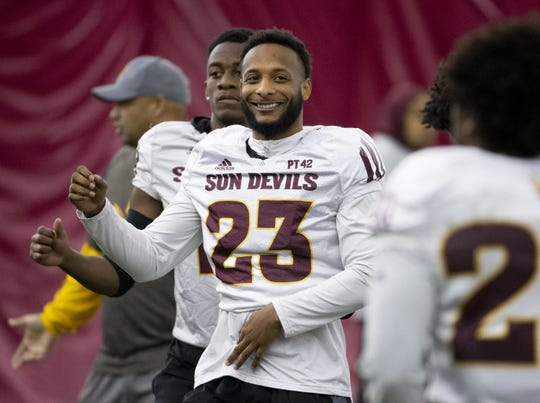 ASU linebacker Tyler Whiley shares a laugh with his teammates during a spring football practice on Feb. 21.