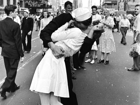 This outtake from shots taken by photographer Alfred Eisenstaedt for Life magazine on Aug. 14, 1945 as revelers in Time Square celebrated the end of the war show's the sailor's date Rita Petry just over his shoulder.