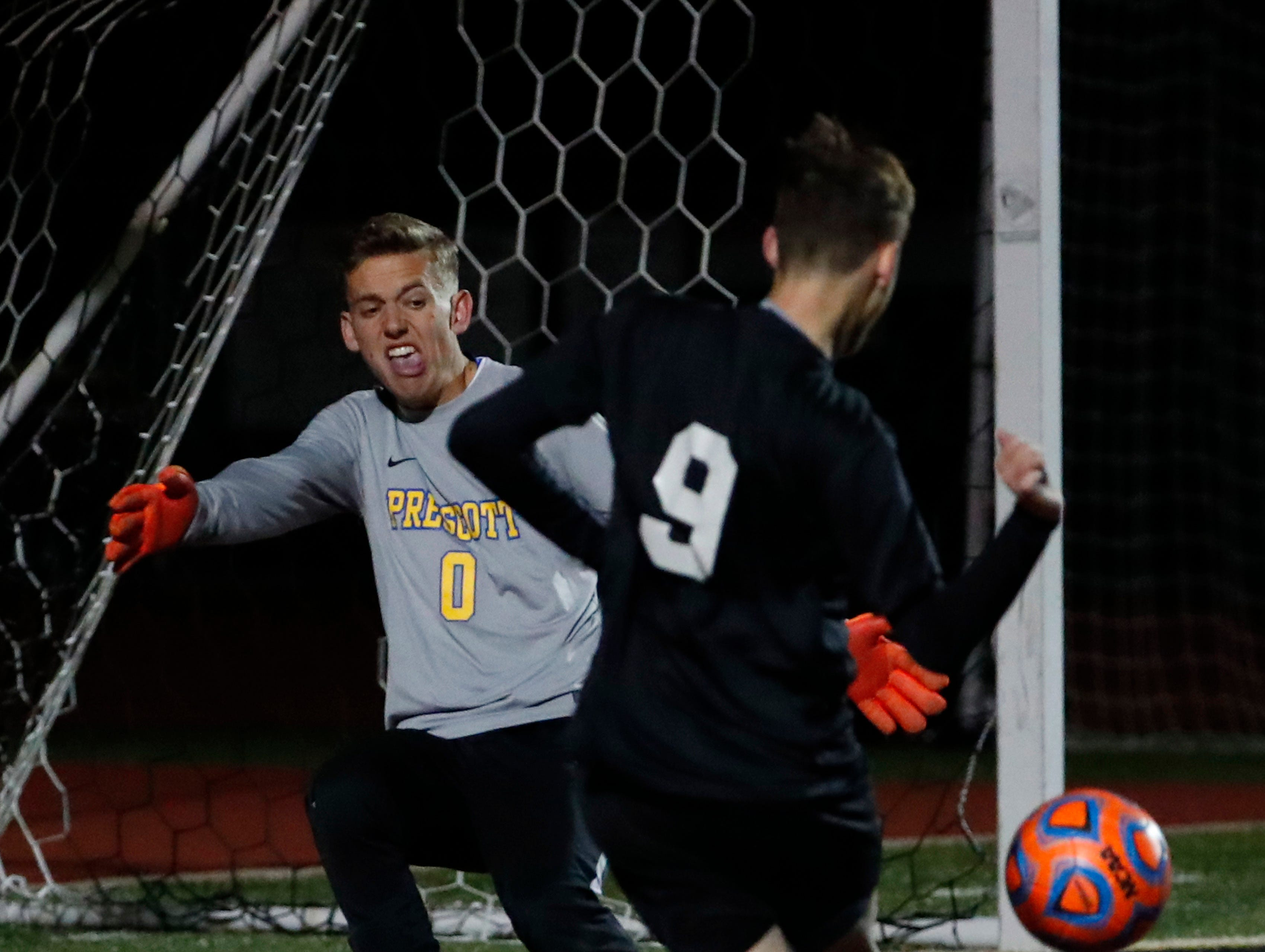 Salpointe's Francisco Manzo (9) takes a shot against Prescott goal keeper Ryan Peeples during the Boys 4A State Championship soccer game in Gilbert Feb. 19, 2019.The shot went high.