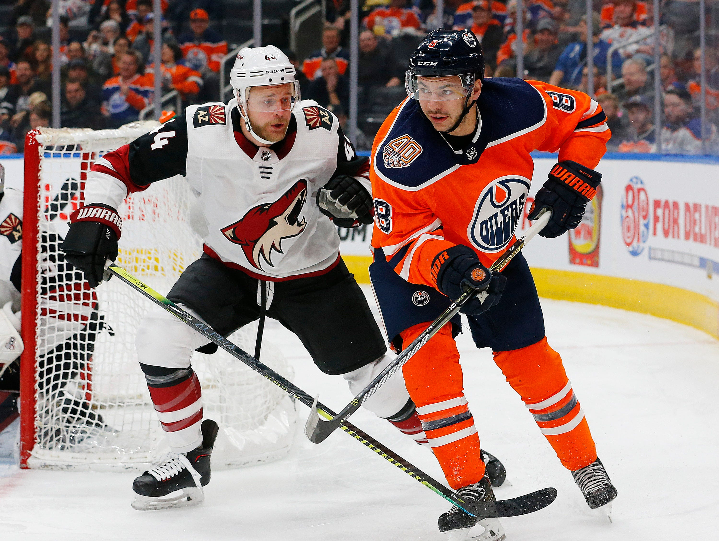 Feb 19, 2019; Edmonton, Alberta, CAN; Arizona Coyotes defensemen Kevin Connauton (44) and Edmonton Oilers forward Ty Rattie (8) look for a loose puck during the first period at Rogers Place. Mandatory Credit: Perry Nelson-USA TODAY Sports