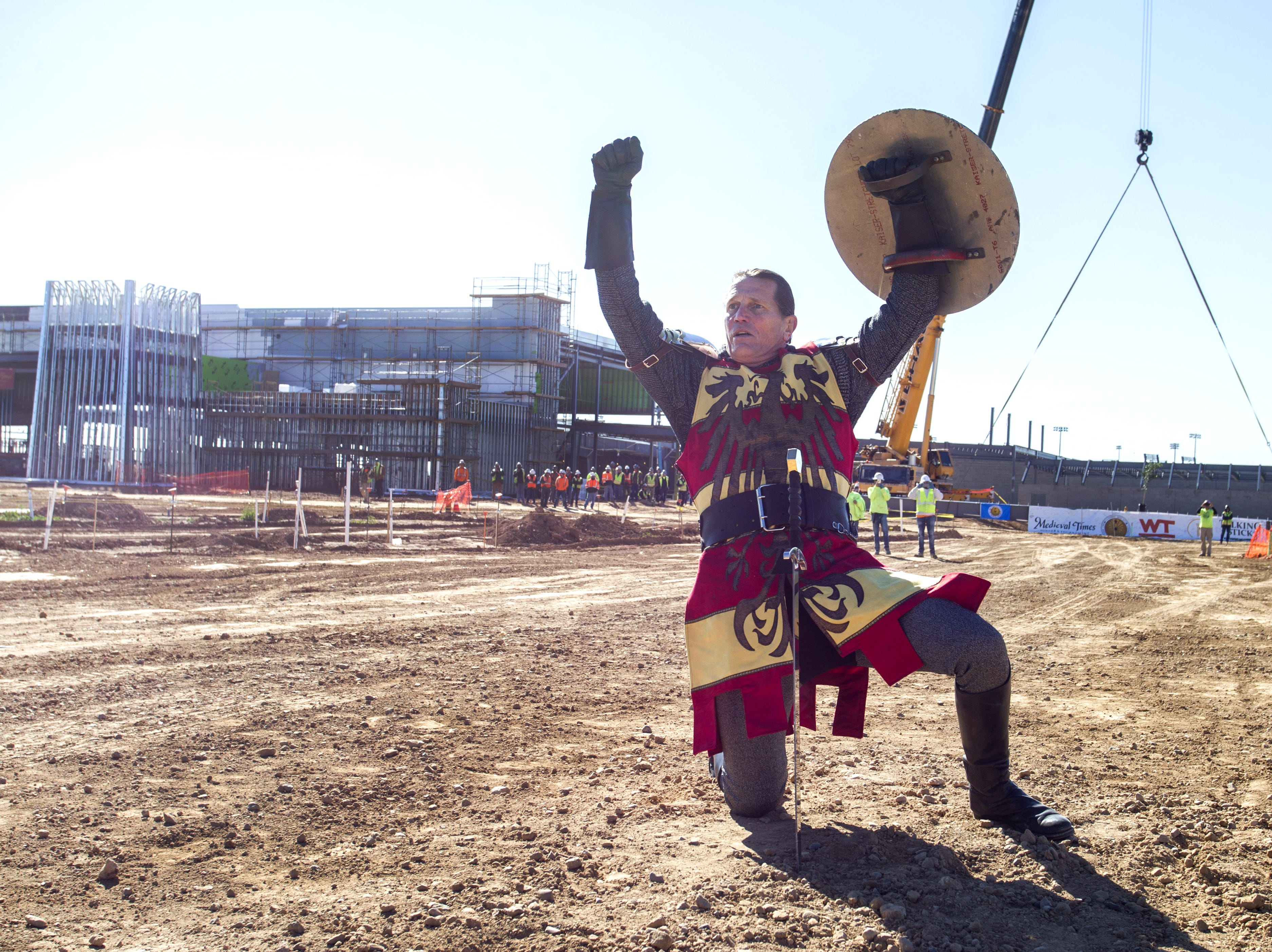 Medieval Times knight Tim Baker celebrates his win over fellow knight Jim Collins in front of the castle that's currently under construction in the Salt River Pima-Maricopa Indian Community's Talking Stick Entertainment District in Scottsdale, Feb, 20, 2019.