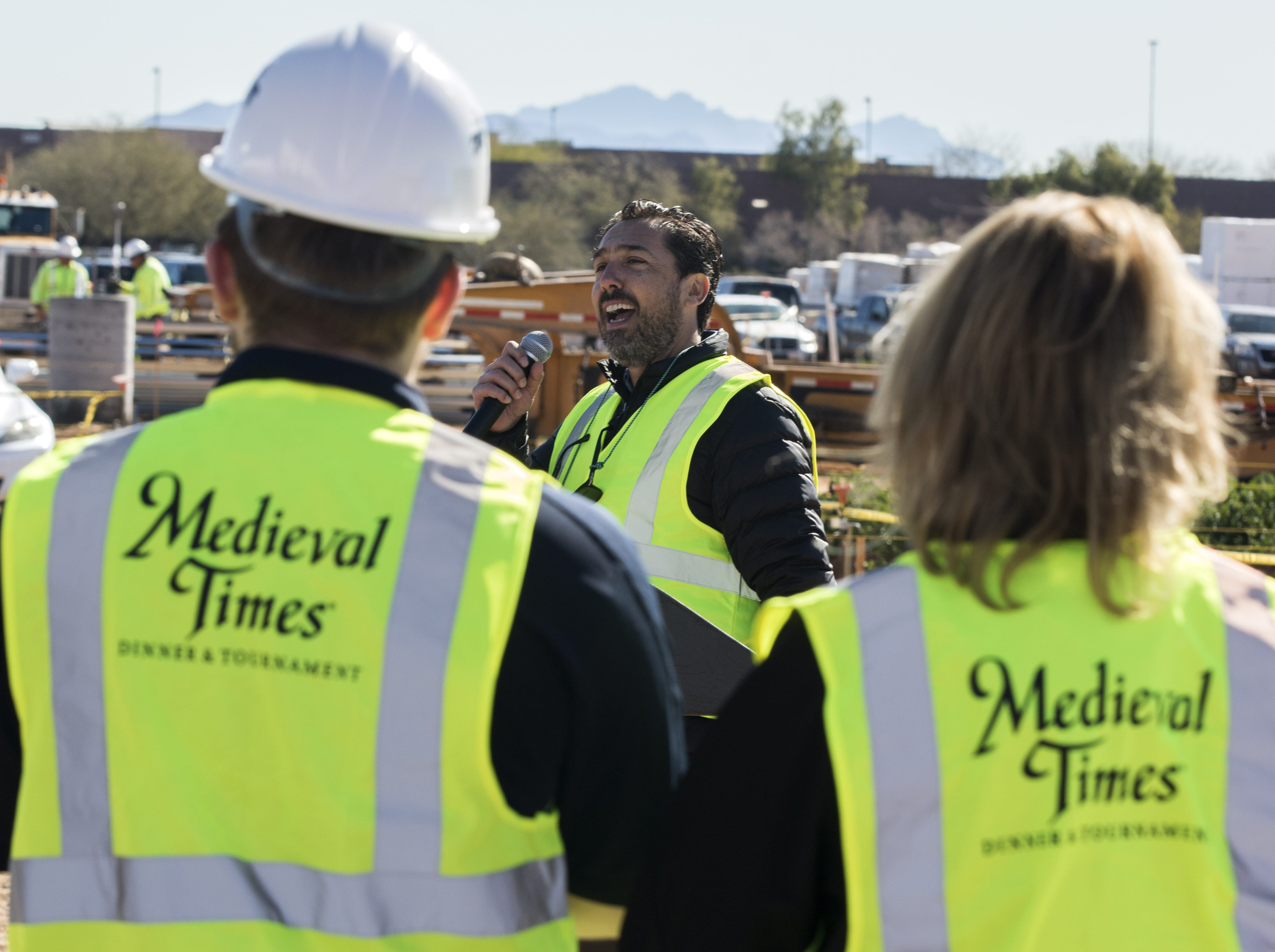 President and CEO of Medieval Times Perico Montaner addresses a crowd on hand to watch the final piece of steel being placed on to the castle coming to the Salt River Pima-Maricopa Indian Community's Talking Stick Entertainment District in Scottsdale, Feb, 20, 2019.
