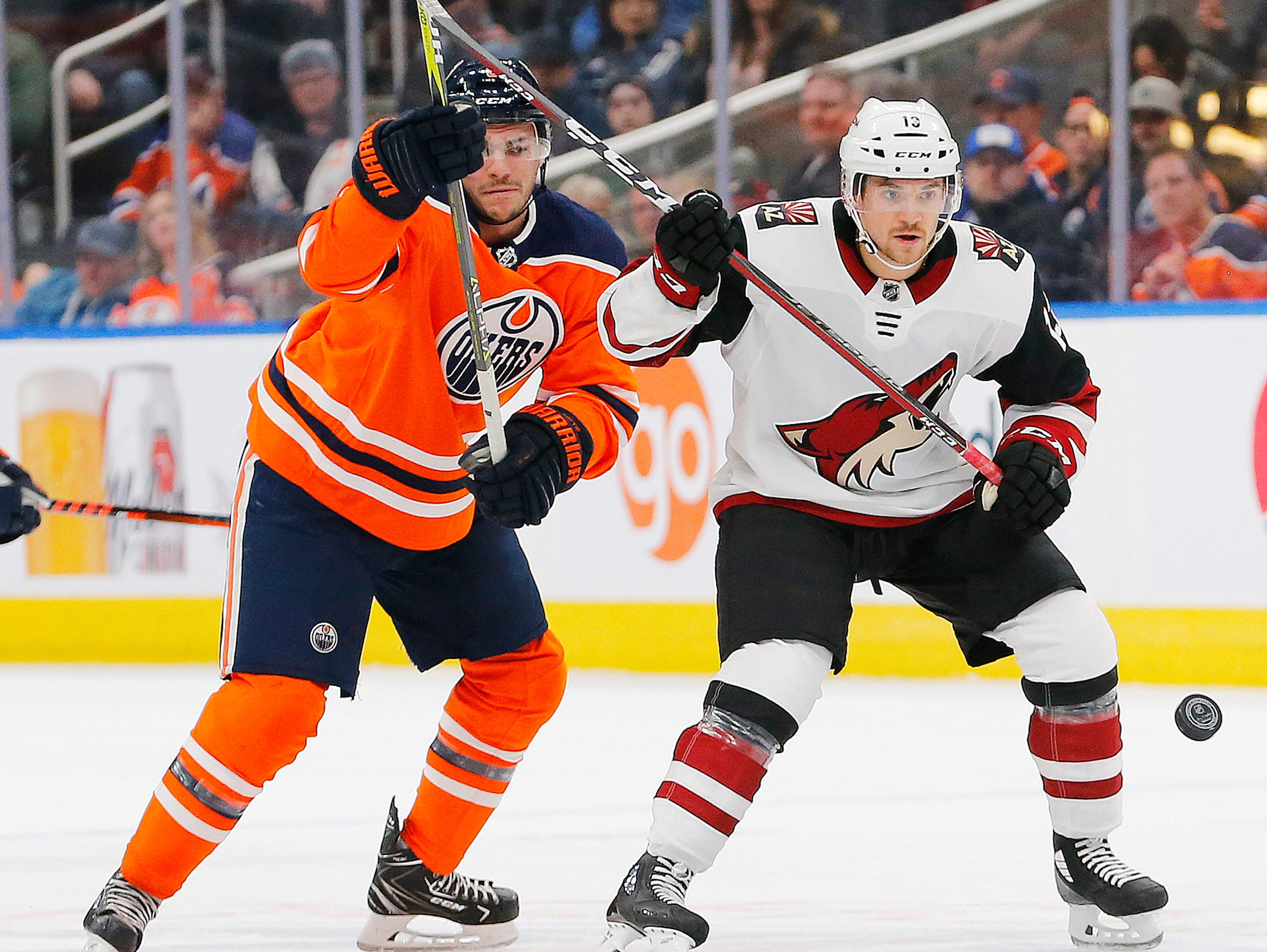 Feb 19, 2019; Edmonton, Alberta, CAN; Edmonton Oilers forward Ty Rattie (8) and Arizona Coyotes forward Vinnie Hinostroza (13) battle for a loose puck during the first period at Rogers Place. Mandatory Credit: Perry Nelson-USA TODAY Sports