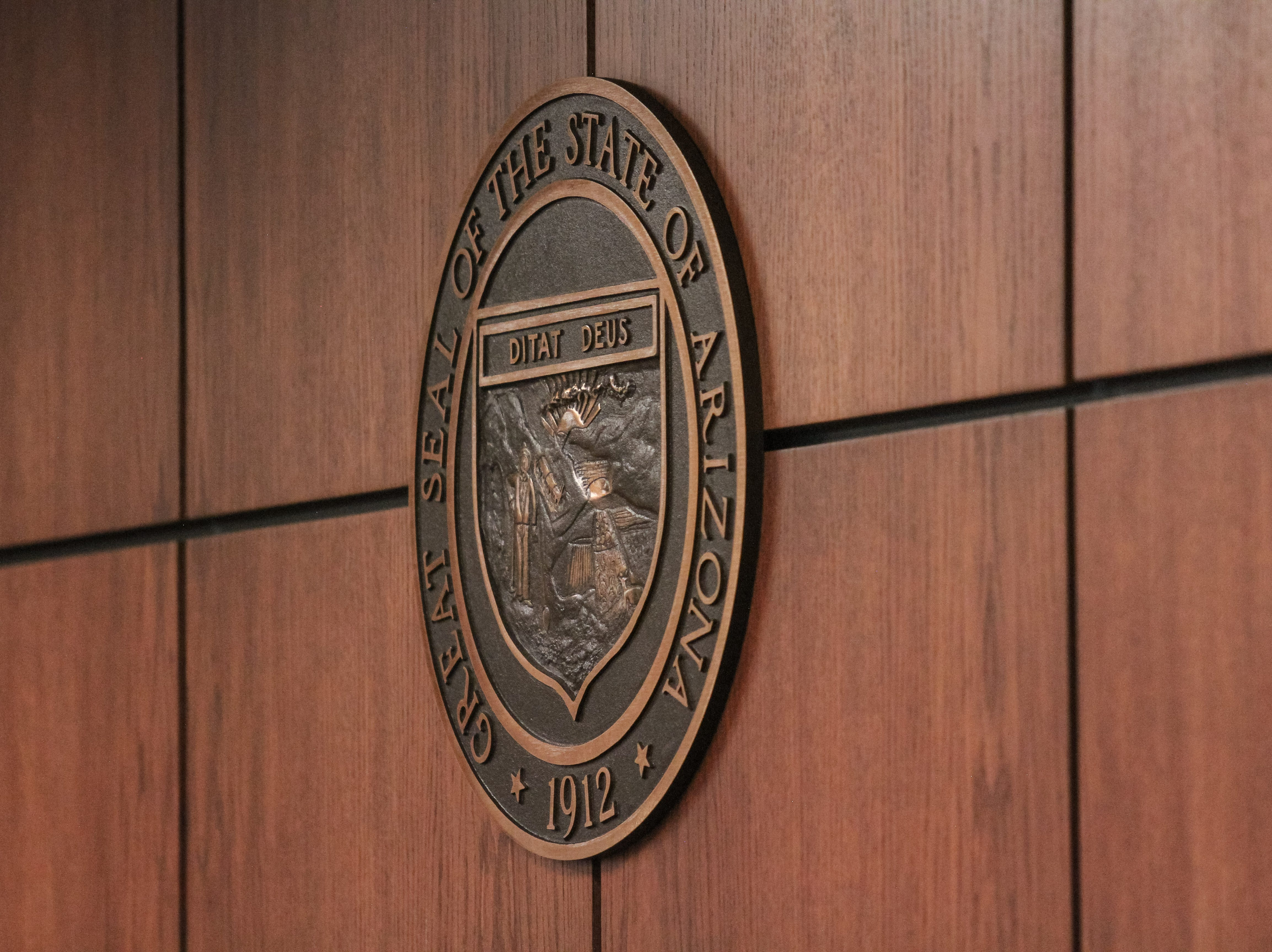 The state seal is pictured at a Senate Transportation and Public Safety hearing at the Arizona State Capitol in Phoenix, Arizona on Wednesday, Feb. 20, 2019.