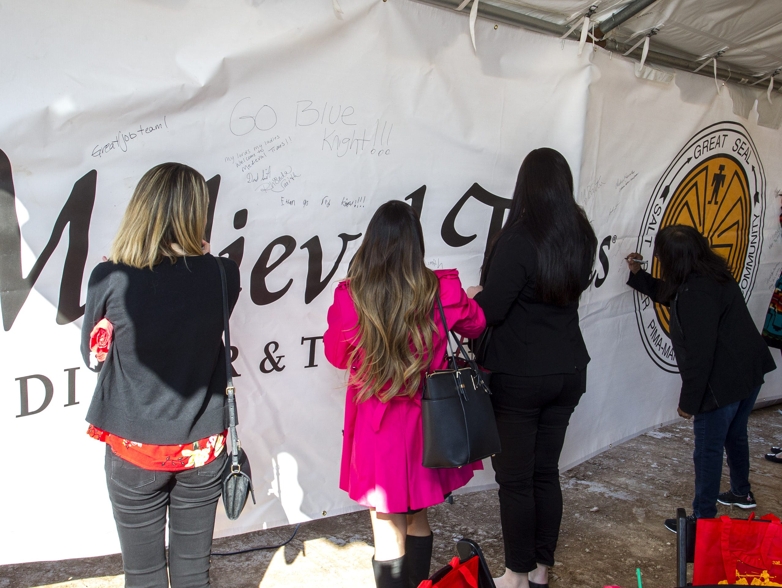 Medieval Times Dinner and Tournament supporters sign a banner that will hang on a 120-foot steel beam inside the castle coming to the Salt River Pima-Maricopa Indian Community's Talking Stick Entertainment District in Scottsdale, Feb, 20, 2019.
