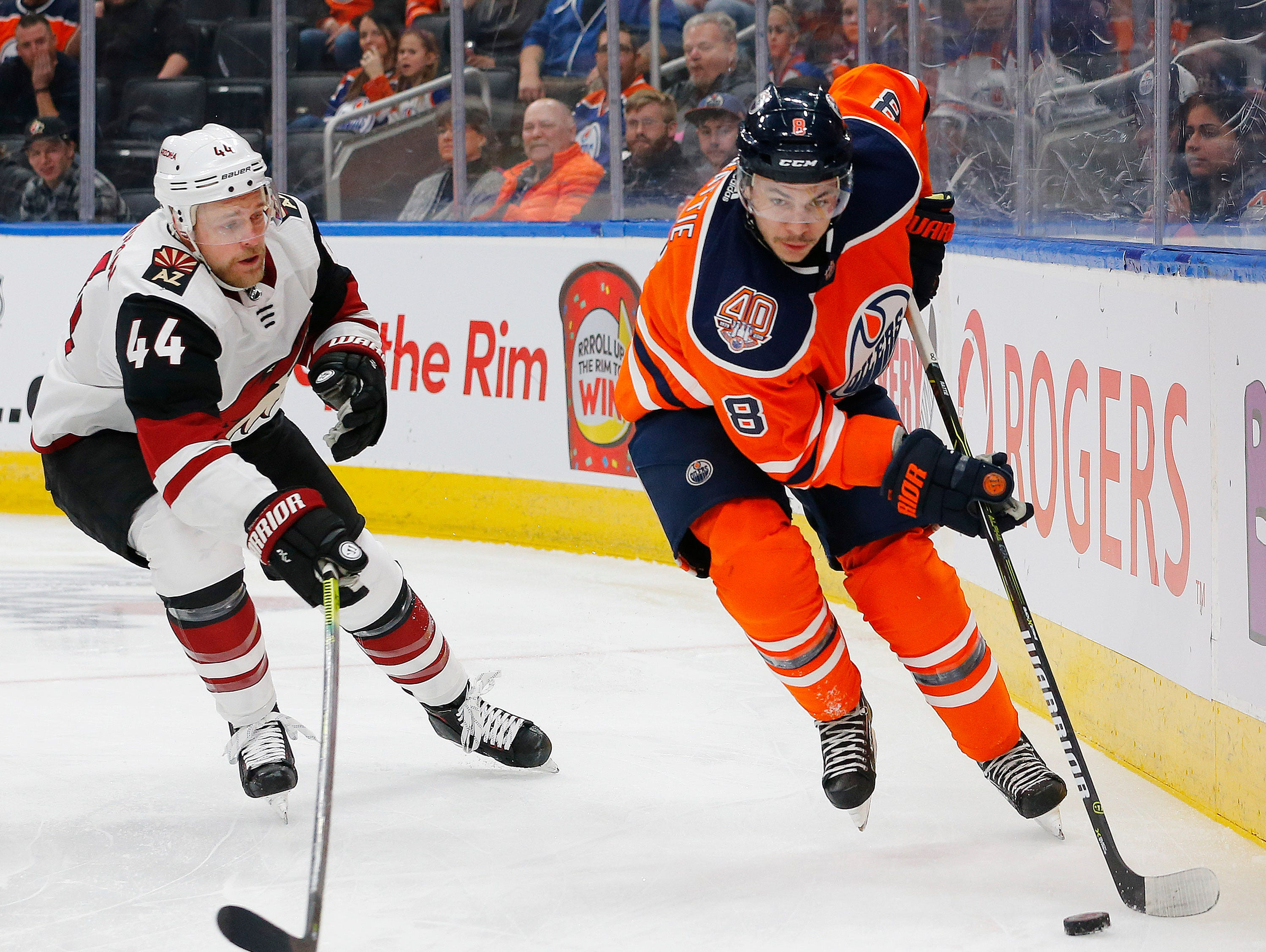 Feb 19, 2019; Edmonton, Alberta, CAN; Edmonton Oilers forward Ty Rattie (8) moves the puck against Arizona Coyotes defensemen Kevin Connauton (44) at Rogers Place. Mandatory Credit: Perry Nelson-USA TODAY Sports
