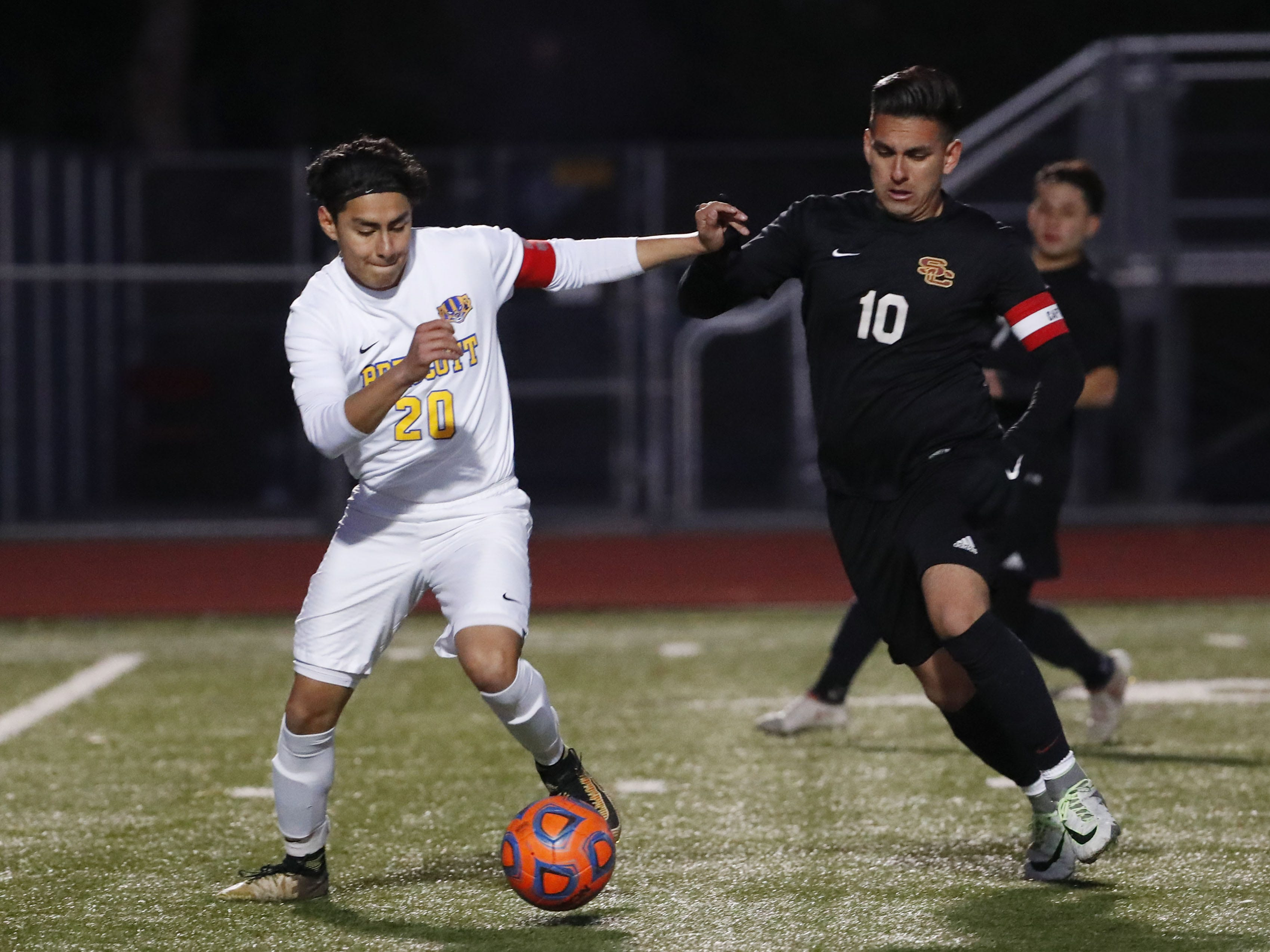 Prescott's Carlos Rivera (20) battles with Salpointe's Alfonso Cabrera (10) during the Boys 4A State Championship soccer game in Gilbert Feb. 19, 2019.