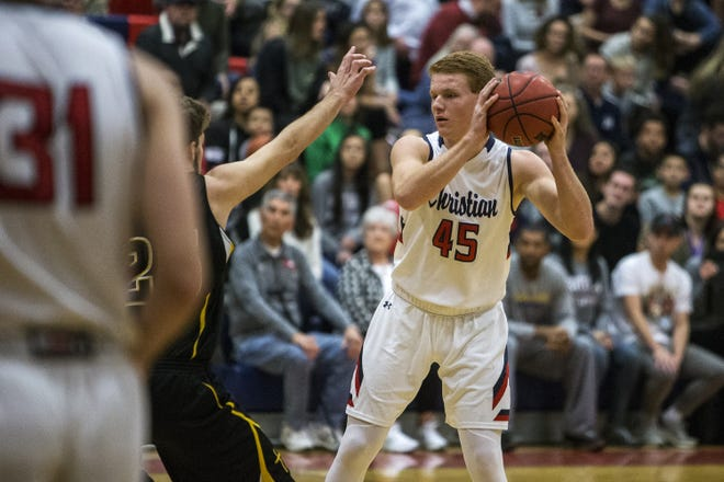 Scottsdale Christian's Tanner Hoffman looks to pass against during a game against Arizona Lutheran Academy on Jan. 5.