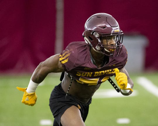 Running back Isaiah Floyd participates in a drill during an ASU spring football practice on Feb. 21.