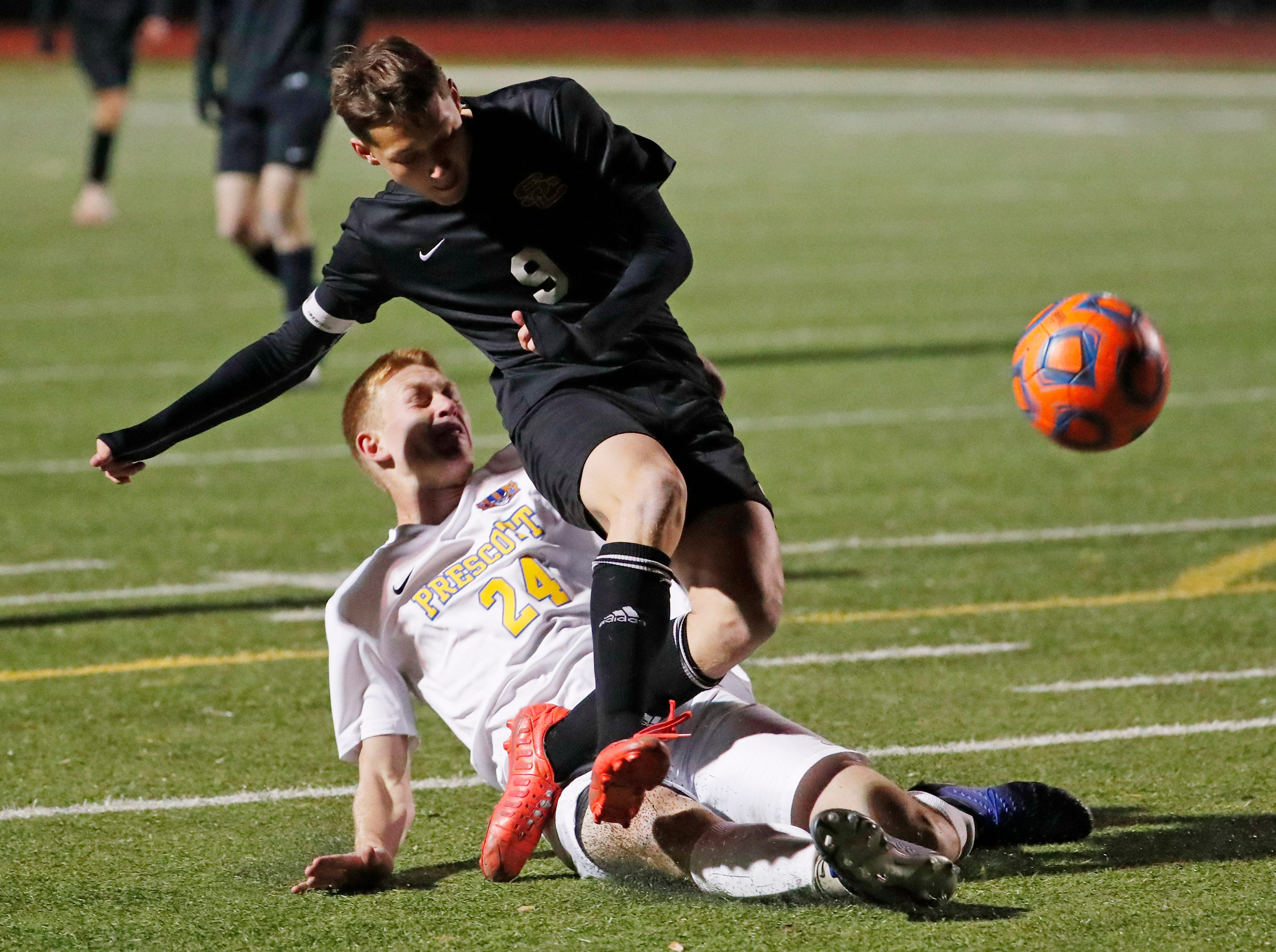 Salpointe's Francisco Manzo (9) is tackled by Prescott's Trevor Cargill (24) during the Boys 4A State Championship soccer game in Gilbert Feb. 19, 2019.