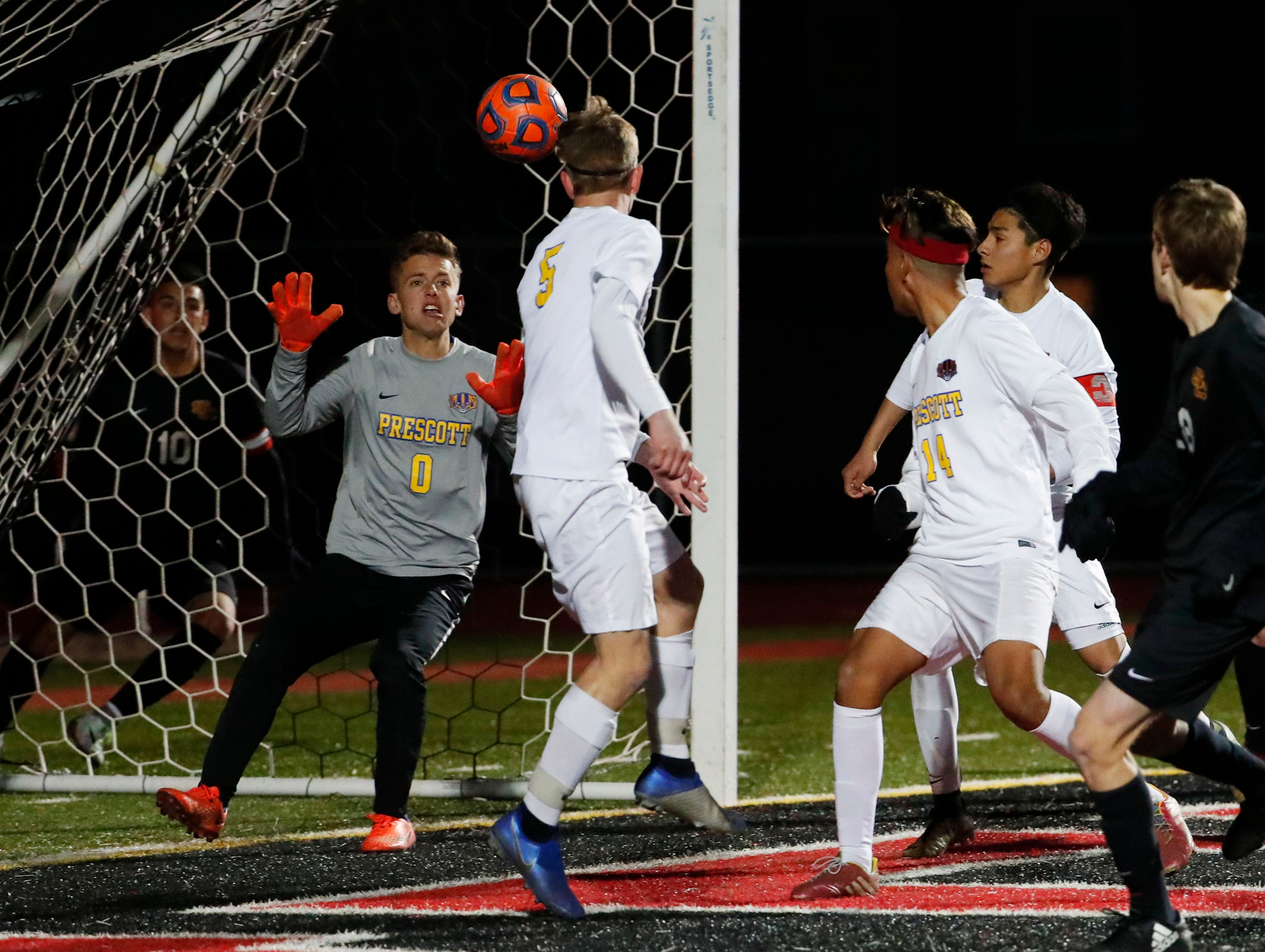 Prescott goal keeper Ryan Peeples makes a save against Salpointe during the Boys 4A State Championship soccer game in Gilbert Feb. 19, 2019.