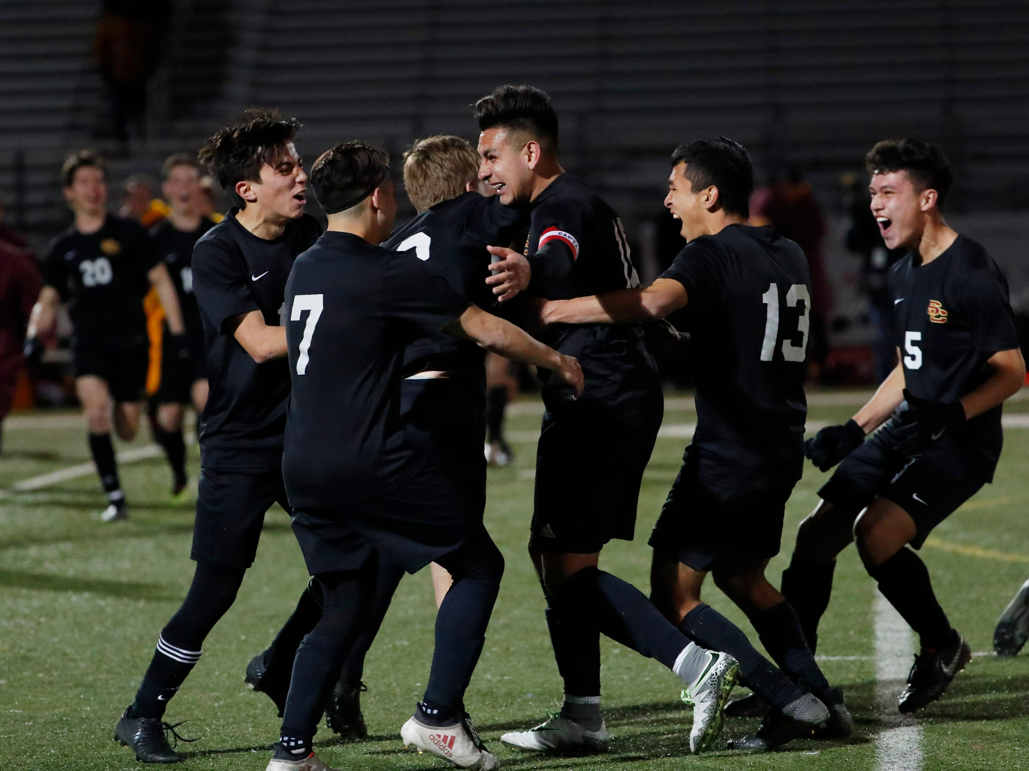 Salpointe players celebrate their 4A State Championship soccer title after beating Prescott 2-1 in Gilbert Feb. 19, 2019.