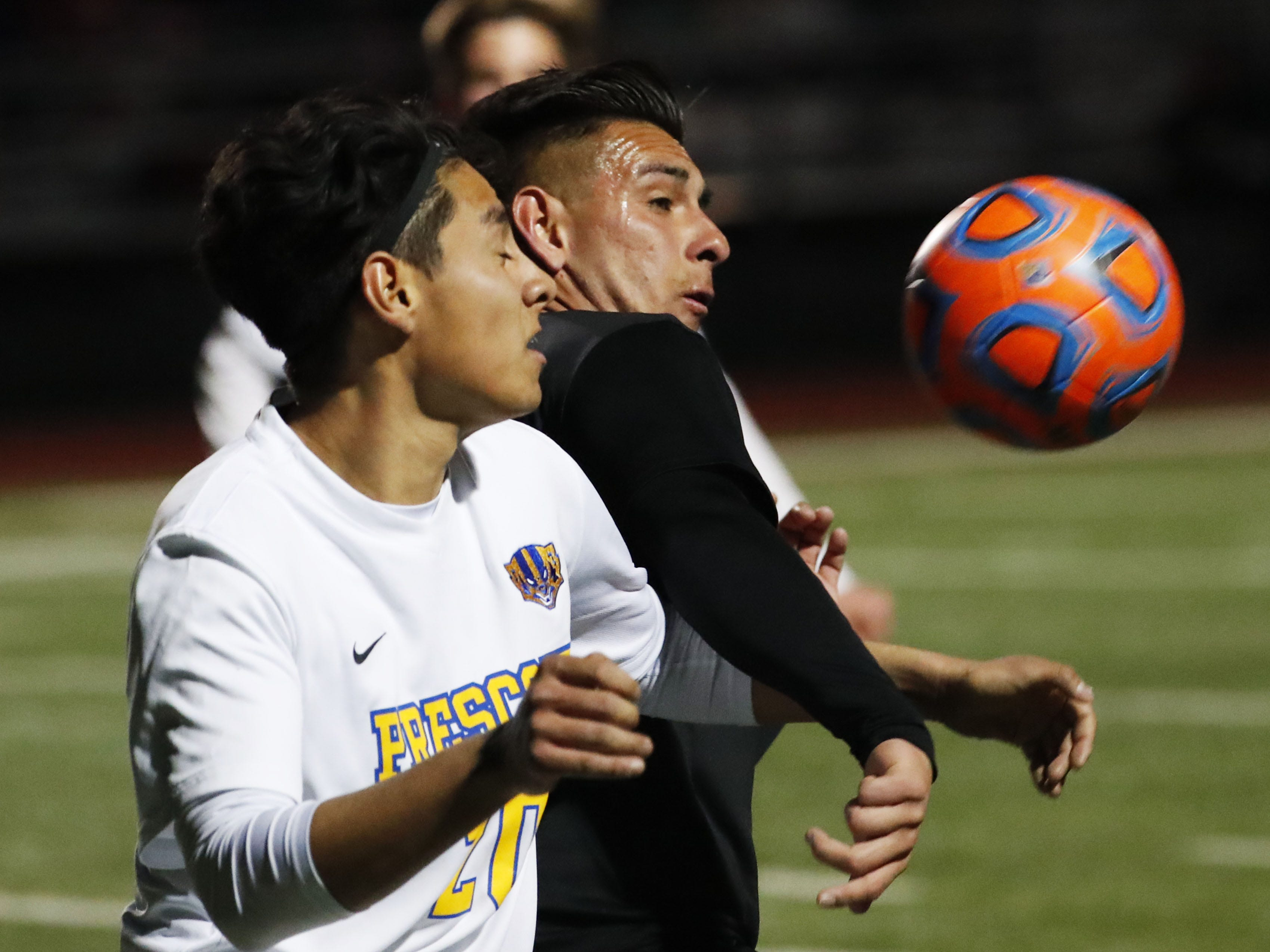 Prescott's Carlos Rivera (left) battles with Salpointe's Alfonso Cabrera (10) during the Boys 4A State Championship soccer game in Gilbert Feb. 19, 2019.