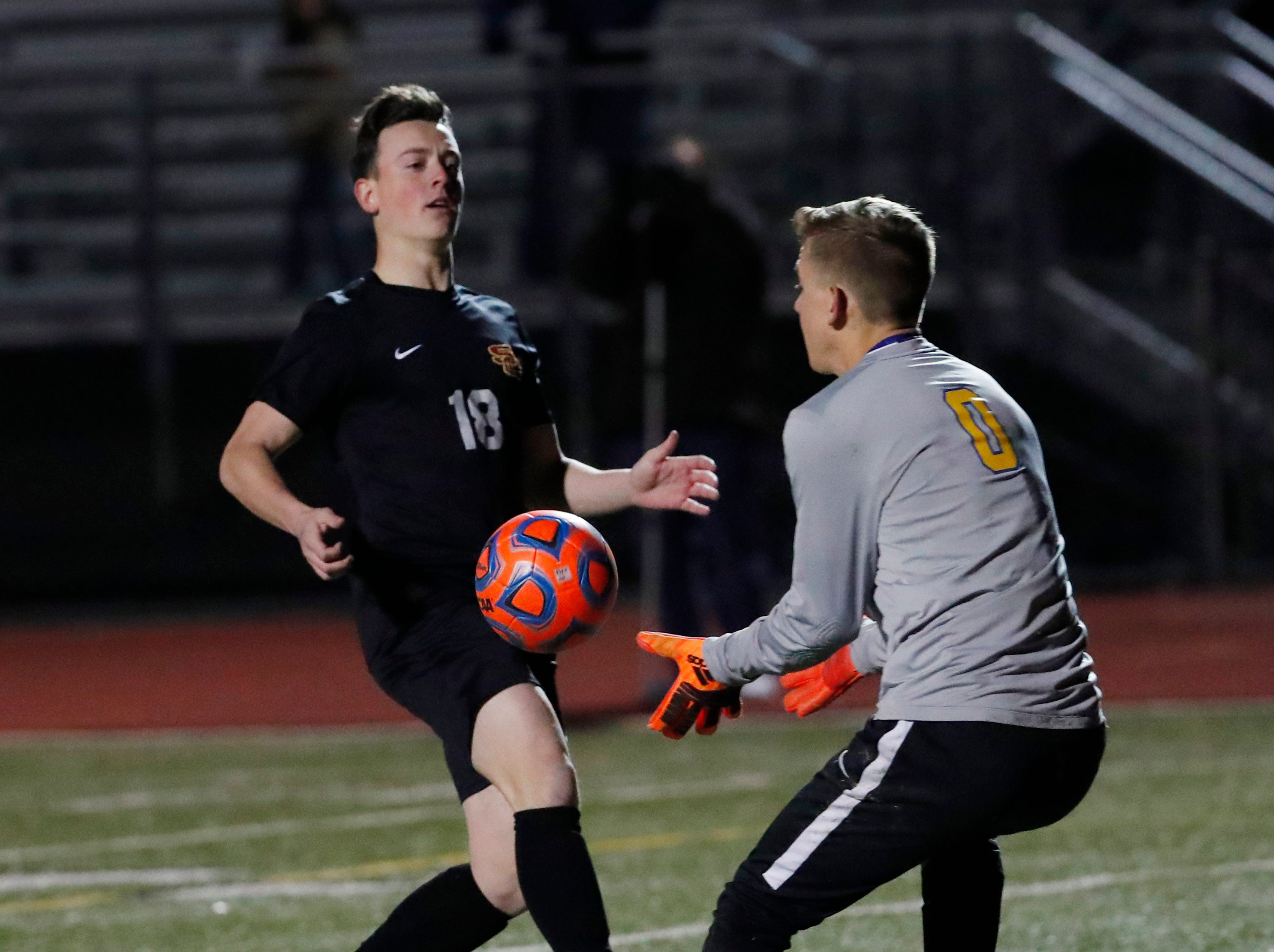 Prescott goal keeper Ryan Peeples grabs the ball while pressured by Salpointe's Tony Villella (18) during the Boys 4A State Championship soccer game in Gilbert Feb. 19, 2019.