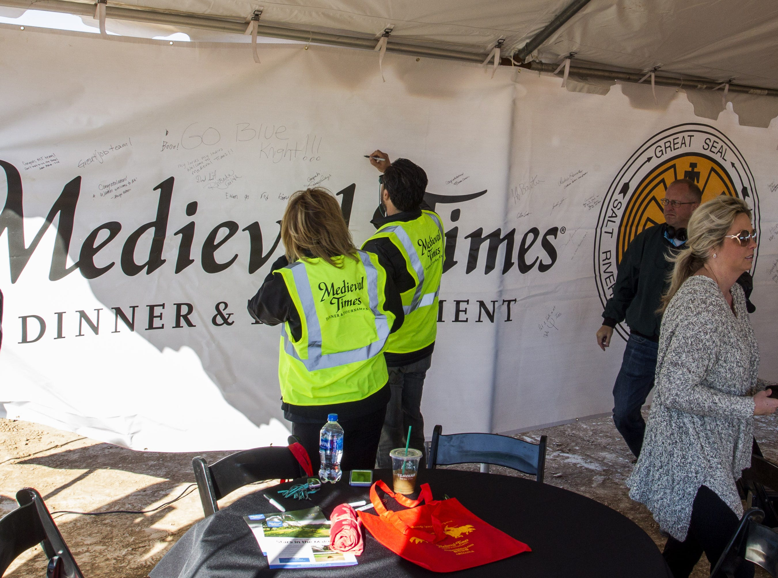 President and CEO of Medieval Times Perico Montaner signs a banner that will hang on a 120-foot steel beam inside the castle coming to the Salt River Pima-Maricopa Indian Community's Talking Stick Entertainment District in Scottsdale, Feb, 20, 2019.