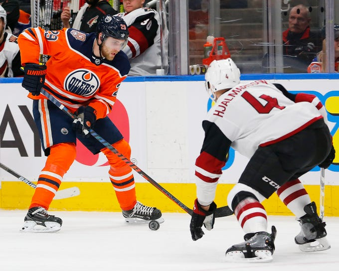 Feb 19, 2019; Edmonton, Alberta, CAN; Edmonton Oilers forward Leon Draisaitl (29) moves against Coyotes defensemen Niklas Hjalmarsson (4) during the first period at Rogers Place. Mandatory Credit: Perry Nelson-USA TODAY Sports