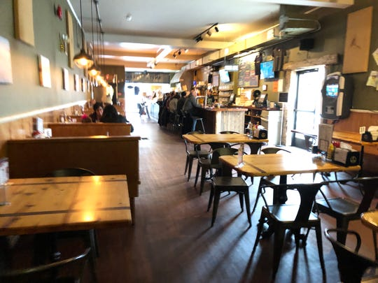 Inside Snitz Creek Brewery on a weekday at lunch, there's a nearly full bar and some full tables as diners take advantage of the great food, beer and specials.