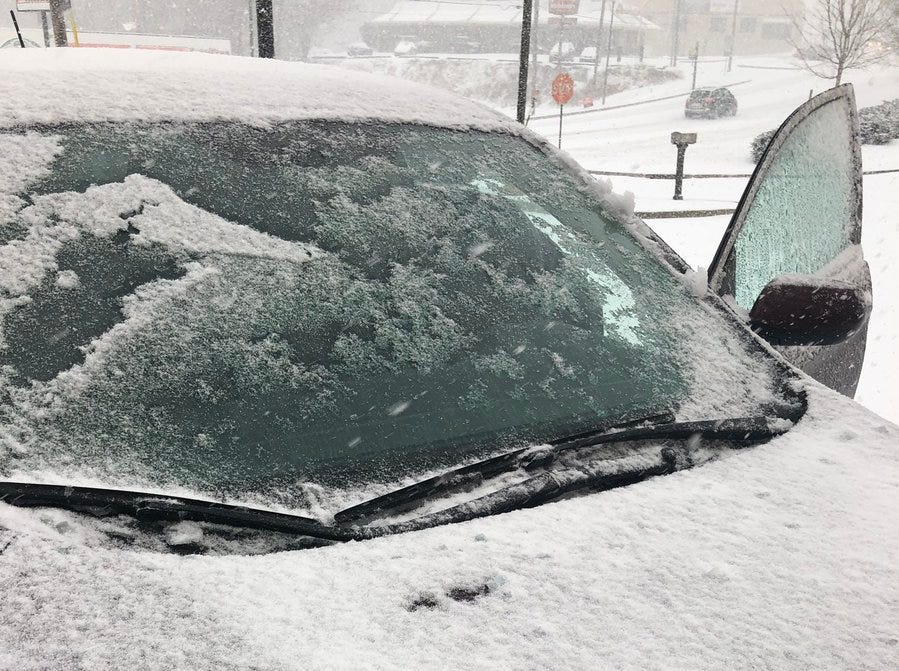 By now, your car is probably looking like this. Prepare to brush and scrape if you need to drive today.