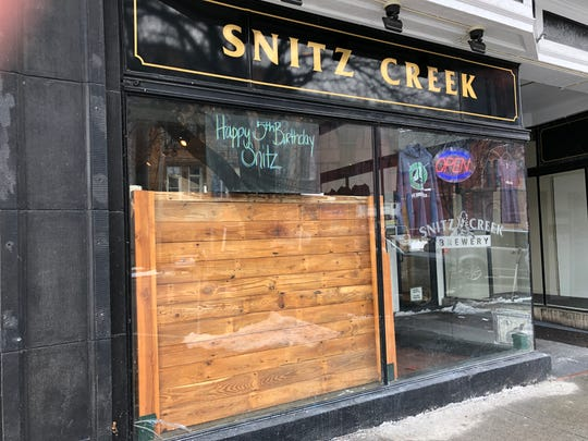 A sign in the window at storefront for Snitz Creek Brewery on North Ninth Street in Lebanon displays a birthday message celebrating the brewpub's fifth anniversary in January.