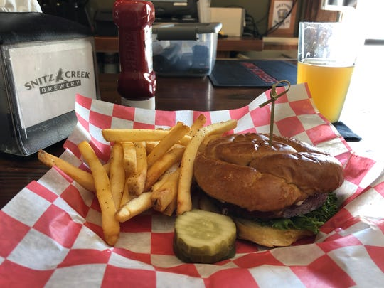 They love their burgers at Snitz Creek Brewery. This is The Snitzer with a side of French fries and a Patrick Doesn't No New England IPA.