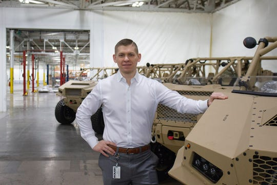 Kyle Jastren, a general manager at Roush Manufacturing and a former U.S. Marine, stands next to a Polaris Dagor, an ultralight tactical vehicle that Roush builds for the U.S. Army and Special Forces.
