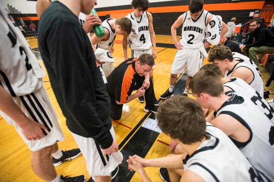 Marine City basketball coach Ron Glodich addresses the team during a time out during their game against Marysville High School Tuesday, Feb. 19, 2019 at Marine City High School.
