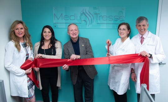 Kimberly Pryslak, NP, Director of Clinical Services; Antonella Montiverdi, Office Manager; Dan Hochvert, Mayor of Scarsdale; Mary Wendel, MD, National Medical Director; and Mark DiStefano, MD, Westchester Medical Director, celebrating the grand opening of Medi Tresse Westchester in Scarsdale, NY.