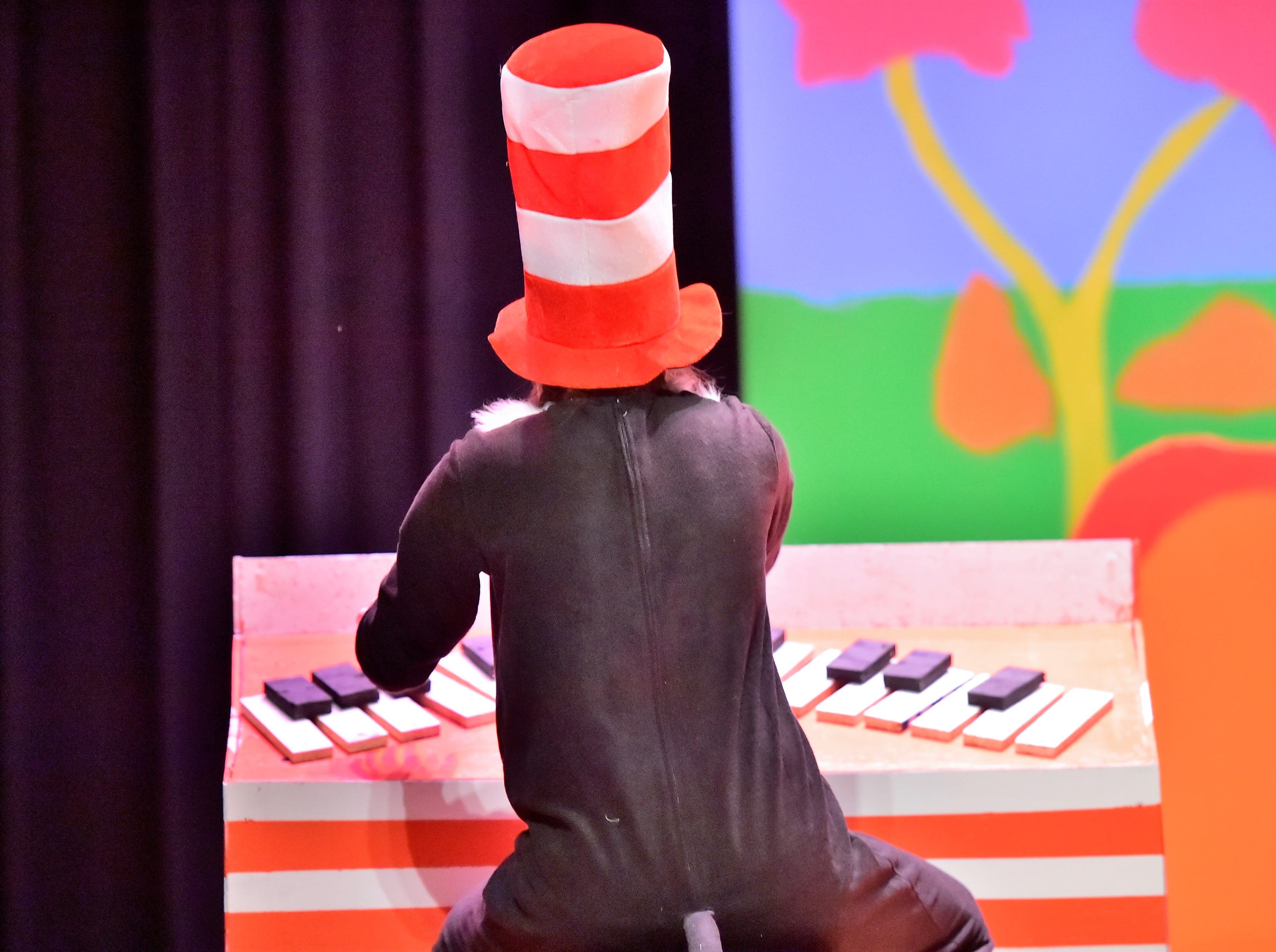 "The Cat in the Hat, played by Anna Maun, plays a keyboard during a dress rehearsal for ""Seussical Jr."" on Feb. 19, 2019. Chambersburg Area Middle School South Drama Club will present the production at 7 p.m. Friday and Saturday, Feb. 22 and 23, and 2 p.m. Saturday and Sunday, Feb. 23 and 24, in the CAMS South auditorium. For tickets, $8, go to www.showtix4u.com and look up CAMS South Seussical."