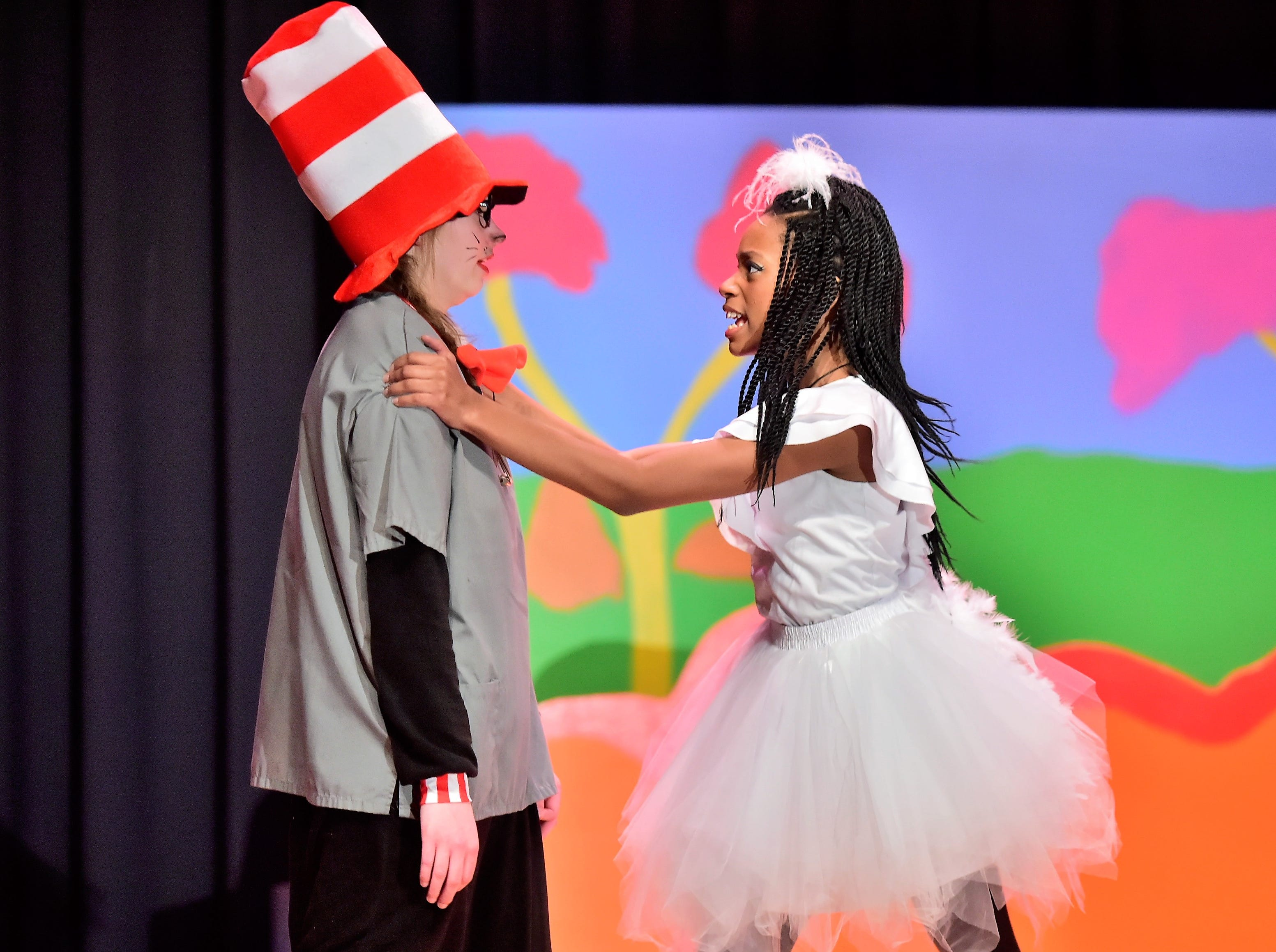 "Jayla Womack, as Gertrude McFuzz, grabs the shoulders of the Cat in the Hat, played by Anna Maun, during a dress rehearsal Tuesday, Feb. 19, 2019, for ""Seussical Jr."" Chambersburg Area Middle School South Drama Club will present the production at 7 p.m. Friday and Saturday, Feb. 22 and 23, and 2 p.m. Saturday and Sunday, Feb. 23 and 24, in the CAMS South auditorium. For tickets, $8, go to www.showtix4u.com and look up CAMS South Seussical."