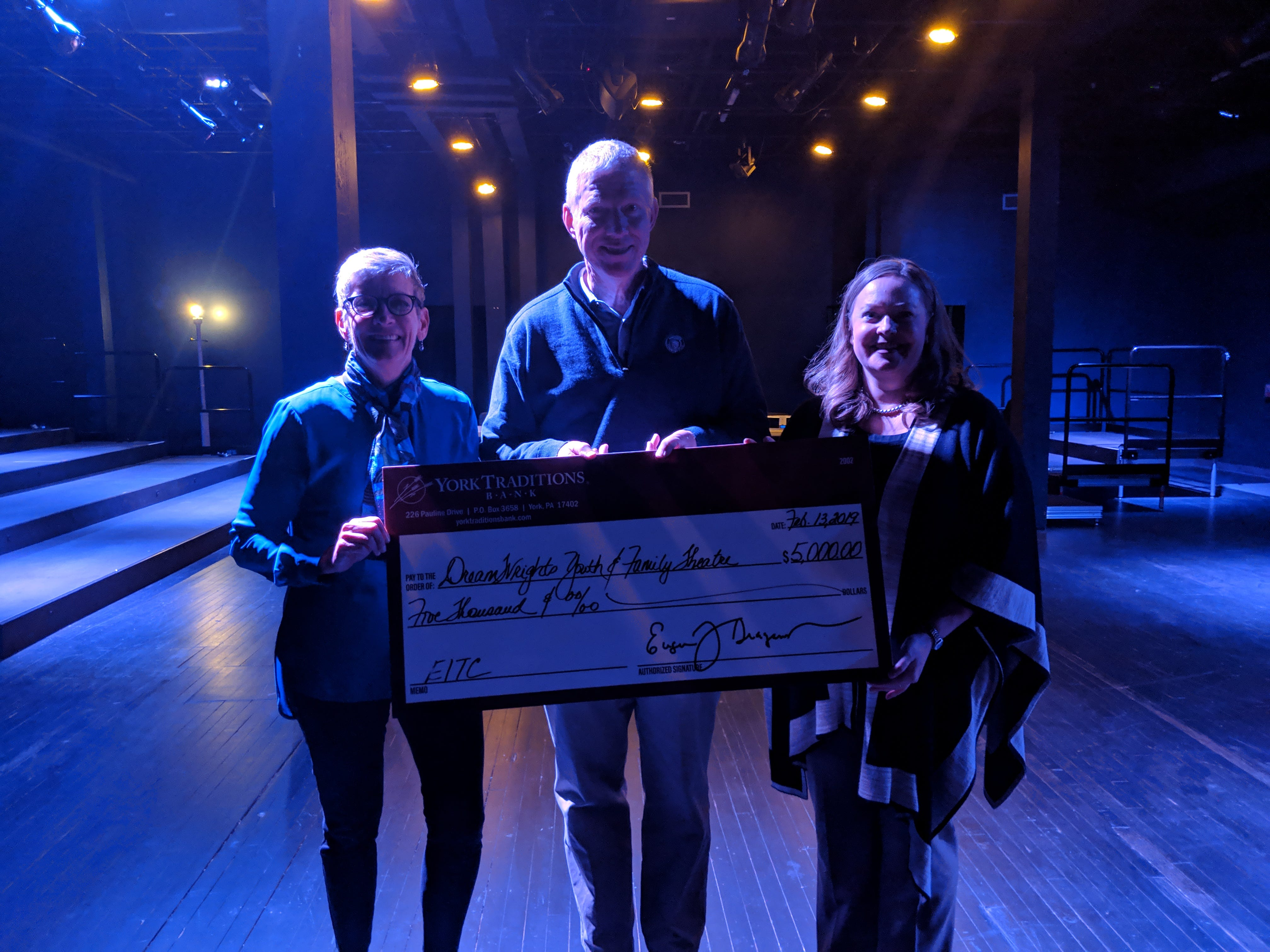 On Wednesday, Feb. 13, 2019, DreamWrights Center for Community Arts received a generous gift of support. John Blecher, CFO of York Traditions Bank, presented a $5,000 check as part of the Bank's EITC gift to DreamWrights. DreamWrights Executive Director Ann Davis (left), and Artistic Director Laurie Riffe (right) accept a check from York Traditions Bank's John Blecher to sponsor the 2019 DreamWrights Studio Season.This gift allows them to sponsor the entire run of 2019 shows in the Studio. A full list of DreamWrights' 2019 season is available at DreamWrights.org. submitted