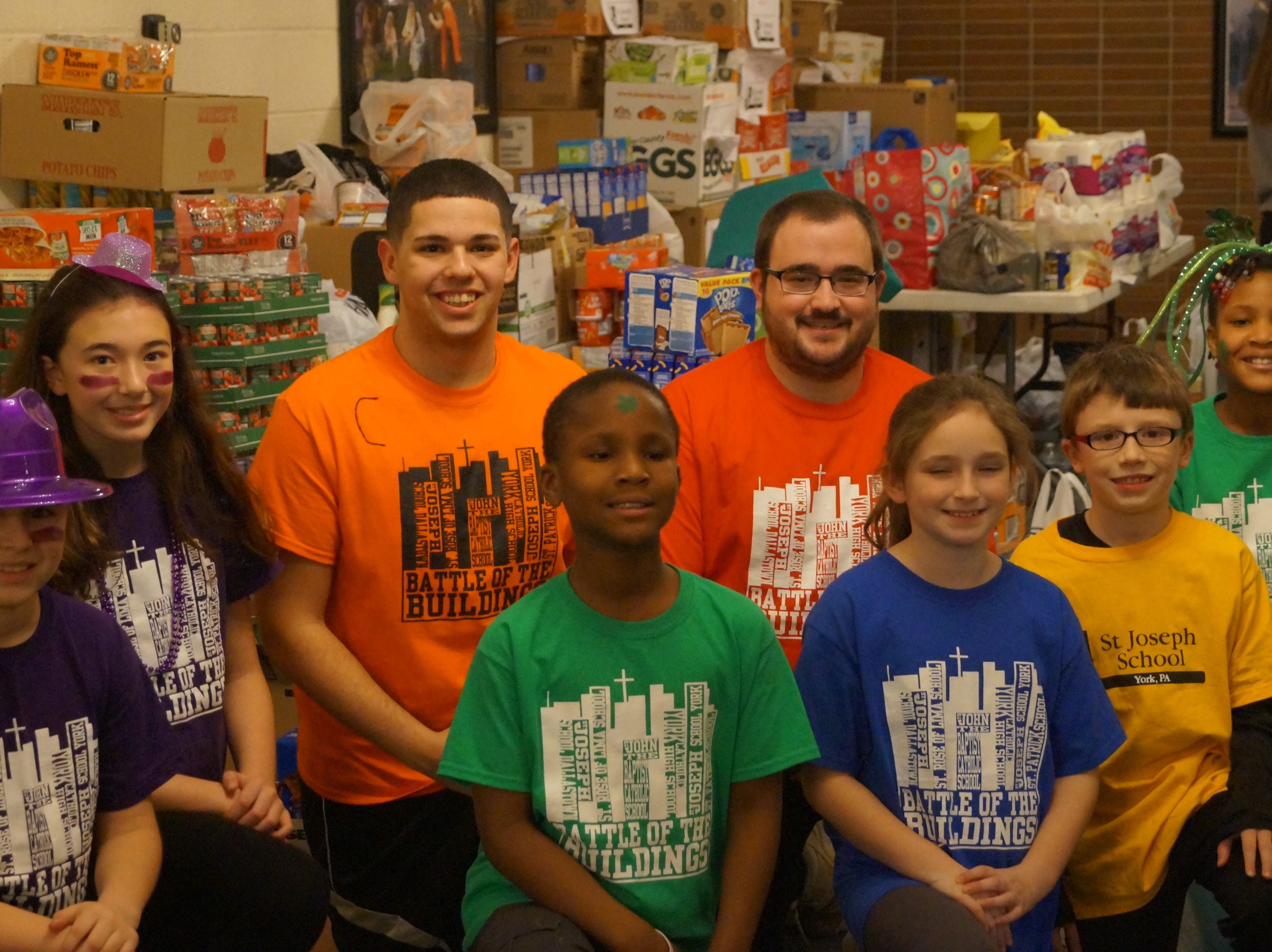 When the Catholic schools in the York area kicked off Catholic School Week, they found a way to help the community while celebrating.  Instead of charging a fee at the annual Battle of the Buildings event, canned goods were collected for the Catholic Harvest Food Pantry.  When all of the counting was complete, the students from St. John the Baptist, St. Joseph Dallastown, St. Joseph York, St. Patrick, St. Rose of Lima, and York Catholic collected over 21,000 items.  Catholic Harvest Food Pantry reported that the collection weighed about 12,500 pounds and was by far the biggest single event donation they had ever received.  Pictured, from left, are representatives from the schools:  Evan Kipple, St. Rose; Emily Werner, St. Rose; Tony Staub, York Catholic; DonGabriel Constant, St. Patrick; Josh Cross, York Catholic; Summer Antkowiak, St. John the Baptist; Kyle Olinger, St. Joseph York and Acilia Constant, St. Patrick. submitted
