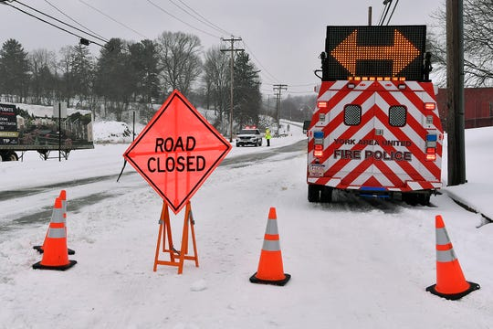 York Area United fire police close Mount Zion Road at Pleasant Valley Road after several vehicles weren't able to make it safely up the hill and were stranded, Wednesday, February 20, 2019. 