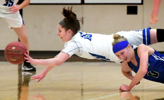 Spring Grove's Ellie Glass dives for a loose ball with Cocalico's Hannah Custer in District 3 Class 5-A girls' basketball game at Spring Grove Tuesday, Feb. 19, 2019. Bill Kalina photo