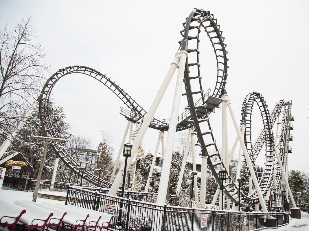 An awesome shot of the Sidewinder ride taking on some snow.