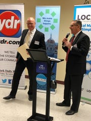 Michael Wynegar, left, regional advertising director, and George Troyano, right, York Newspaper Co. president, presented Gannett Foundation grants Feb. 19, 2019 at a York County Economic Alliance Business After Hours event at the Loretta Claiborne Building in York.