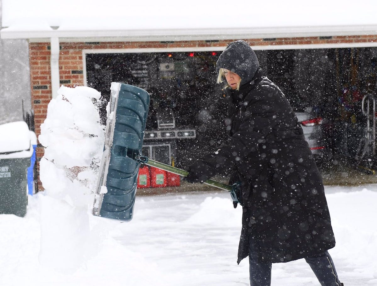 A woman shovels her driveway during a recent blast of snow.