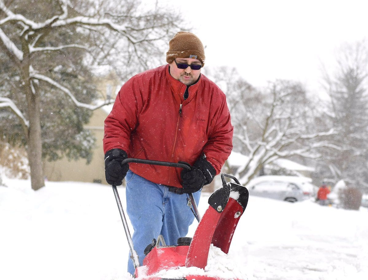 Dave Kauffman broke out the old Honda snowblower to make quick work of the white stuff.