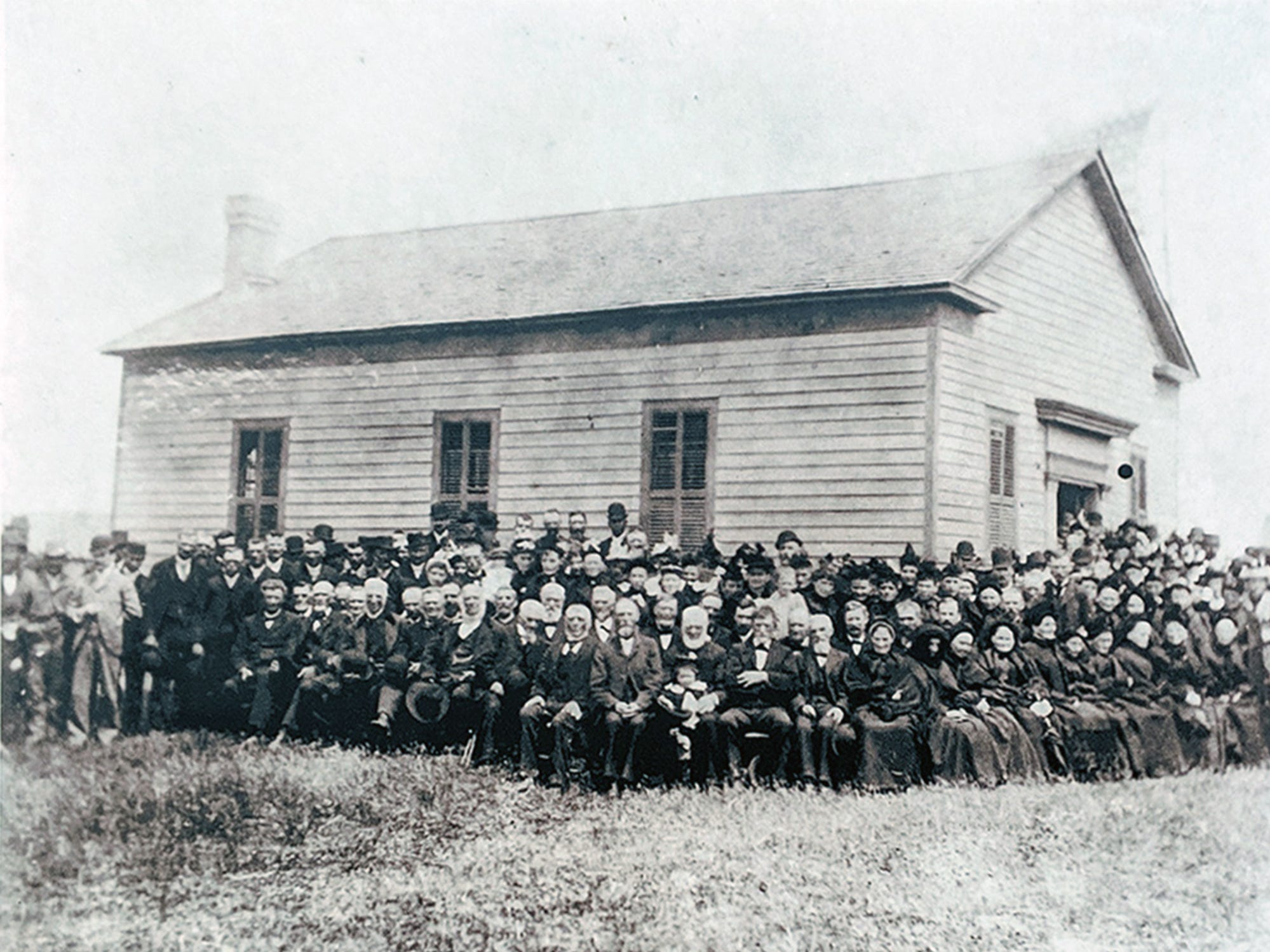 The Welsh Congregational Church was built in 1857. Virtually all  of the people are immigrants. This picture is mounted on an interpretive board in Coulsontown in front of the Welsh quarrymen's cottages.