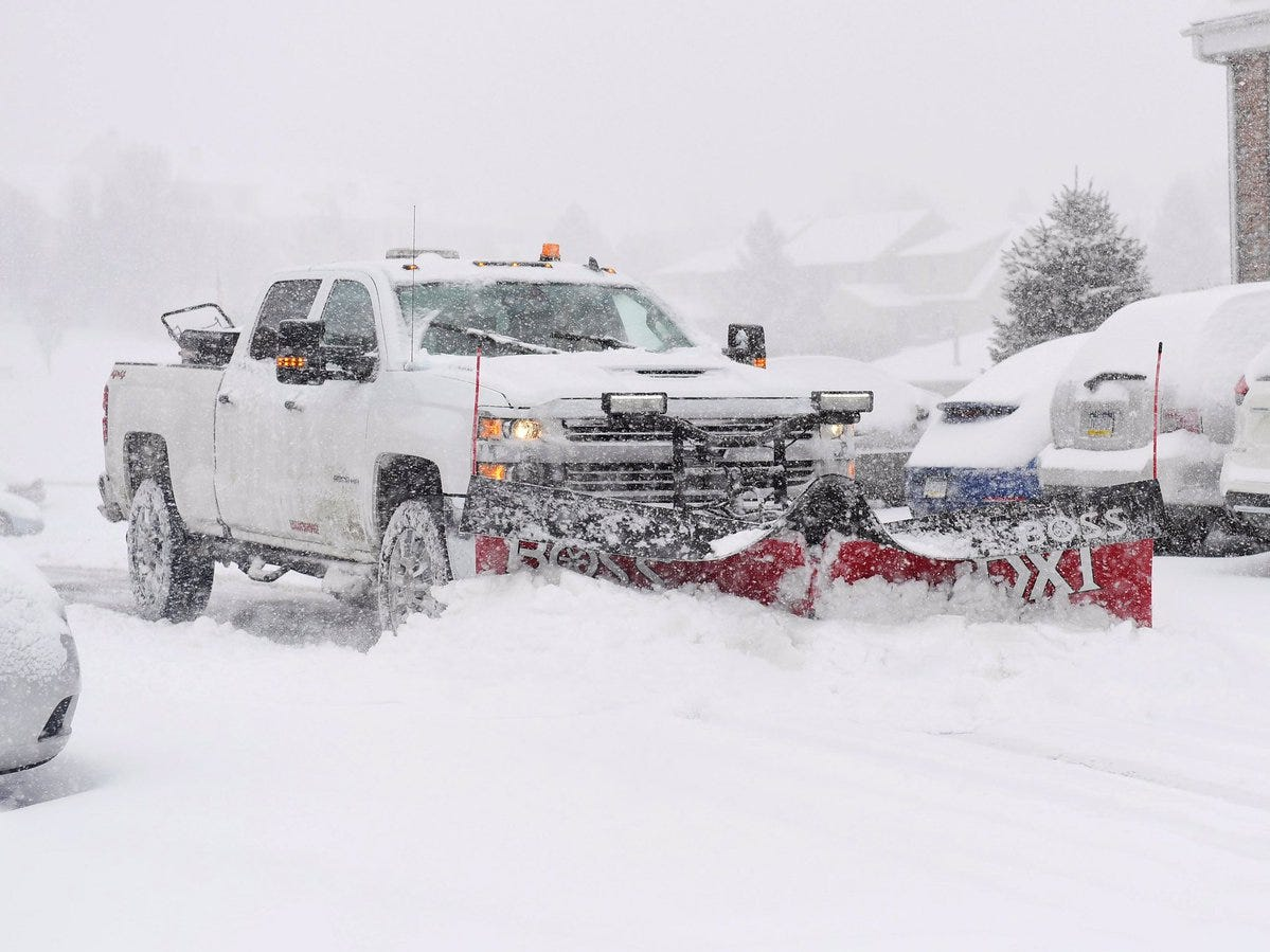 Plow trucks hit the streets and parking lots to clear snow.
