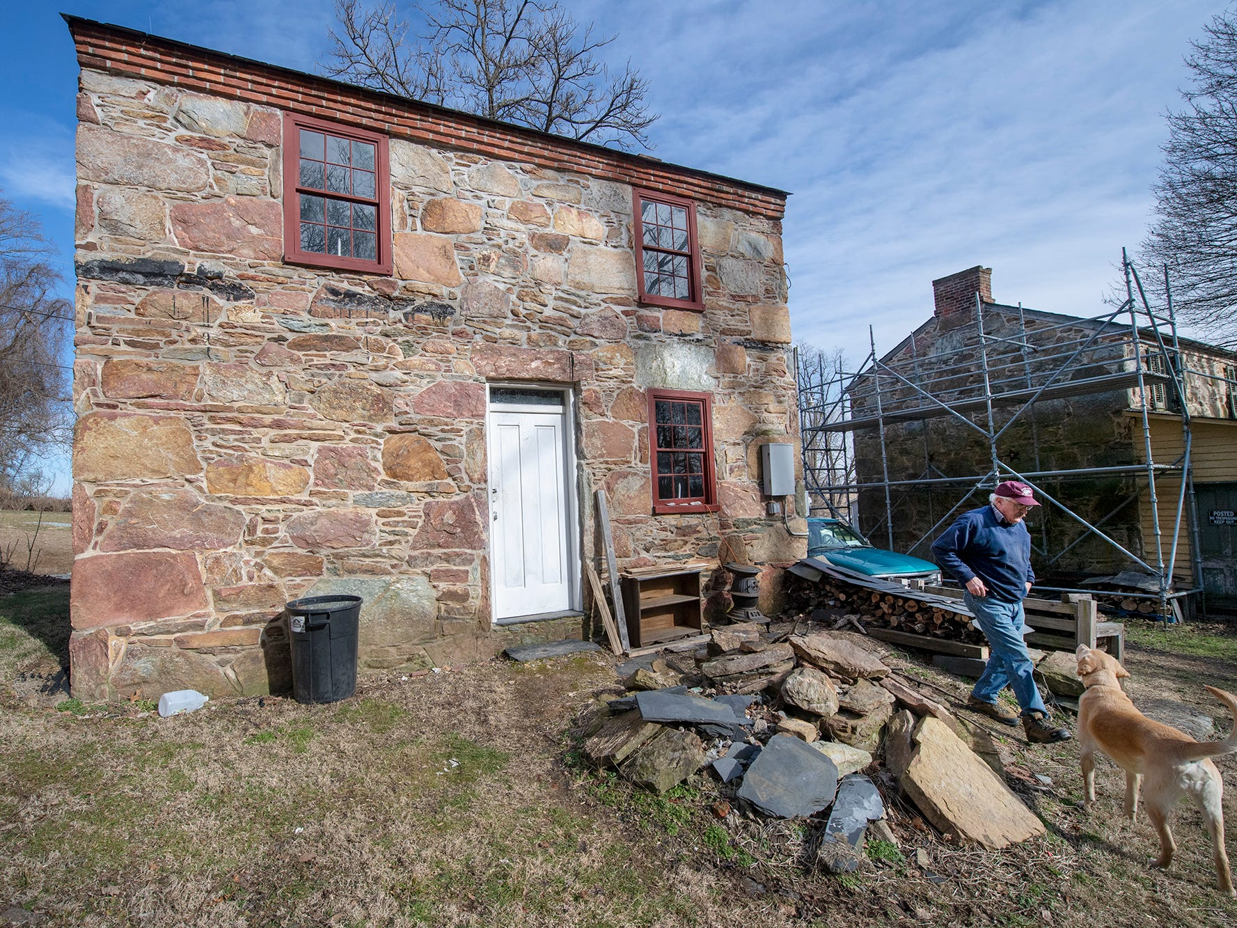 This is the rear of one of the Welsh quarrymen's cottages that was purchased in 2006 with Old Line Museum volunteer Don Robinson and his dog Jake in Peach Bottom Township on February 19, 2019. The cottage at right was stabilized with scaffolding so one wall can eventually be repaired.