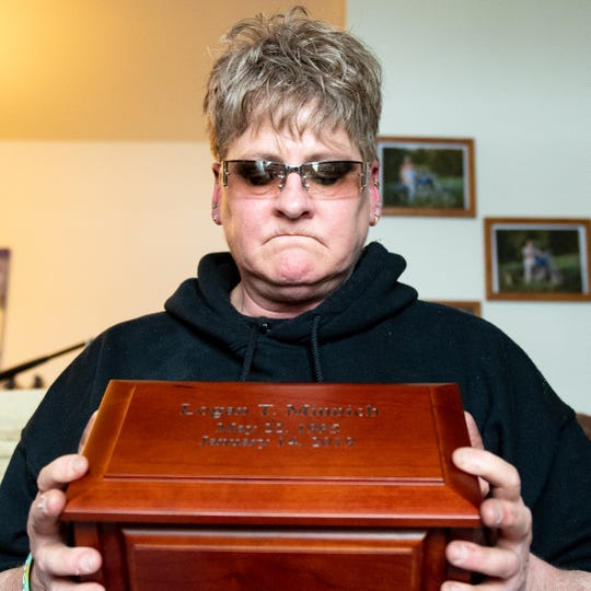 Jamie Minnich remembers her son, Logan, while holding his ashes, February 14, 2019.