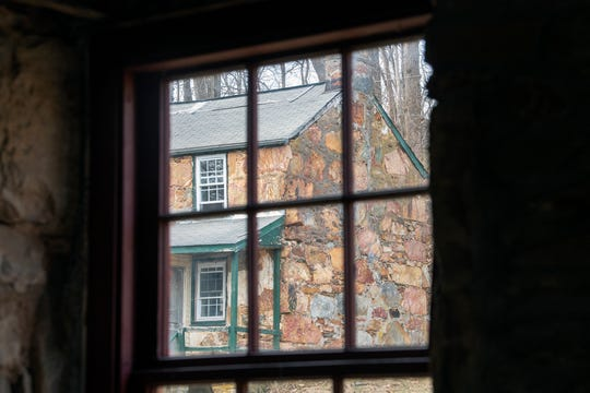 This is looking through the window of an earlier cottage acquisition at the newest Welsh quarrymen's cottage purchase in Coulsontown, Peach Bottom Township on February 19, 2019.