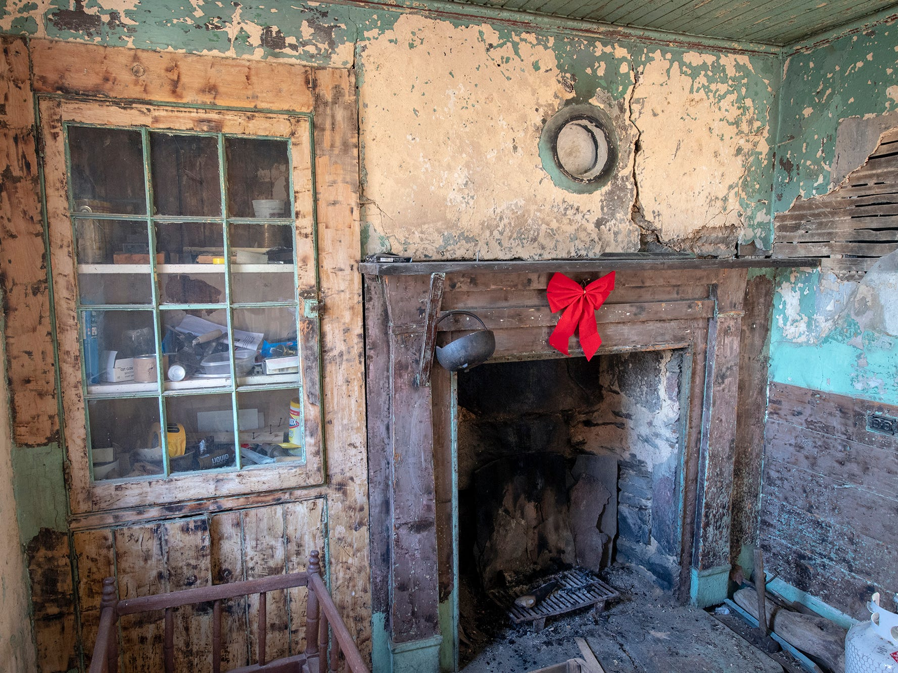 Paint was recently stripped off of woodwork inside another Welsh quarrymen's cottage Old Line Museum purchased for preservation in 2006. The hearth and built-in cupboard were originally part of all the cottages built between 1850 to 1860.