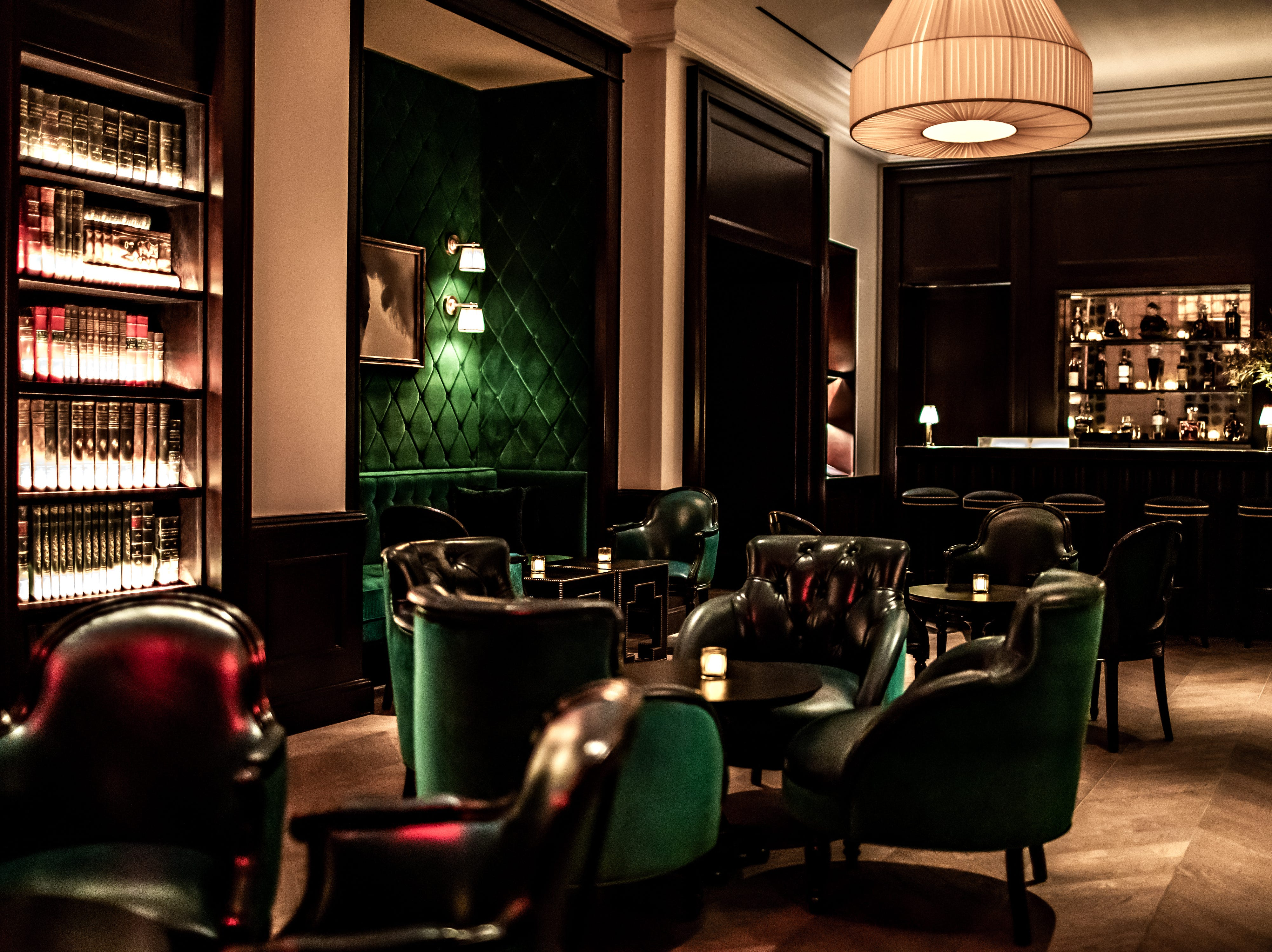 NOMAD RESTAURANT AND BAR in NoMad Las Vegas. The Salon with tufted emerald walls is one of three rooms beyond the main dining room.