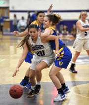 Spanish Springs' Lauryn Dressler drives past Reed's Aliza Mondragon, left, and Tia Henderson to score on Jan. 29, 2019.